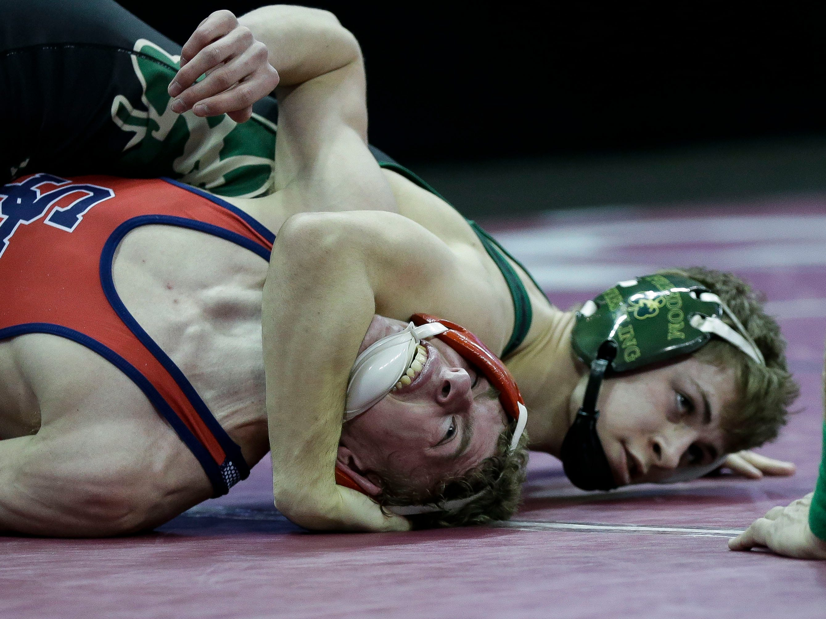 Spencer/Columbus Catholic's Ashton Ackman is pinned by Freedom's Colby McHugh in a Division 2 120-pound preliminary match during the WIAA state wrestling tournament on Thursday, February 21, 2019, at the Kohl Center in Madison, Wis.