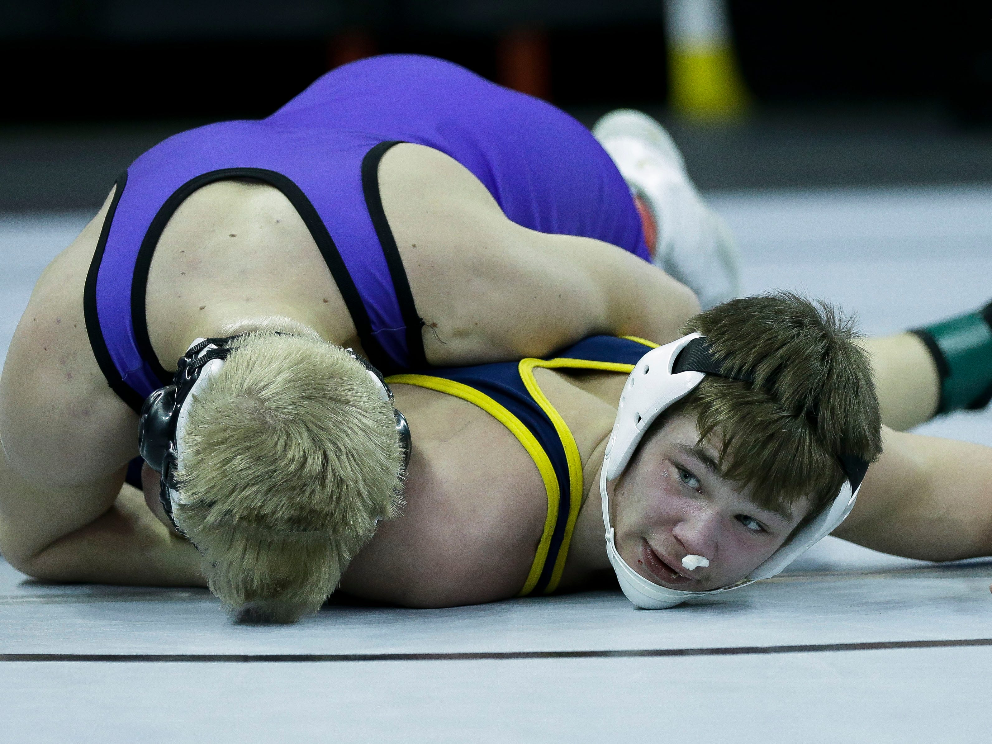 Chilton/Hilbert's Gaven Lisowe looks to his coaches for instruction in a Division 2 152-pound preliminary match during the WIAA state wrestling tournament on Thursday, February 21, 2019, at the Kohl Center in Madison, Wis.