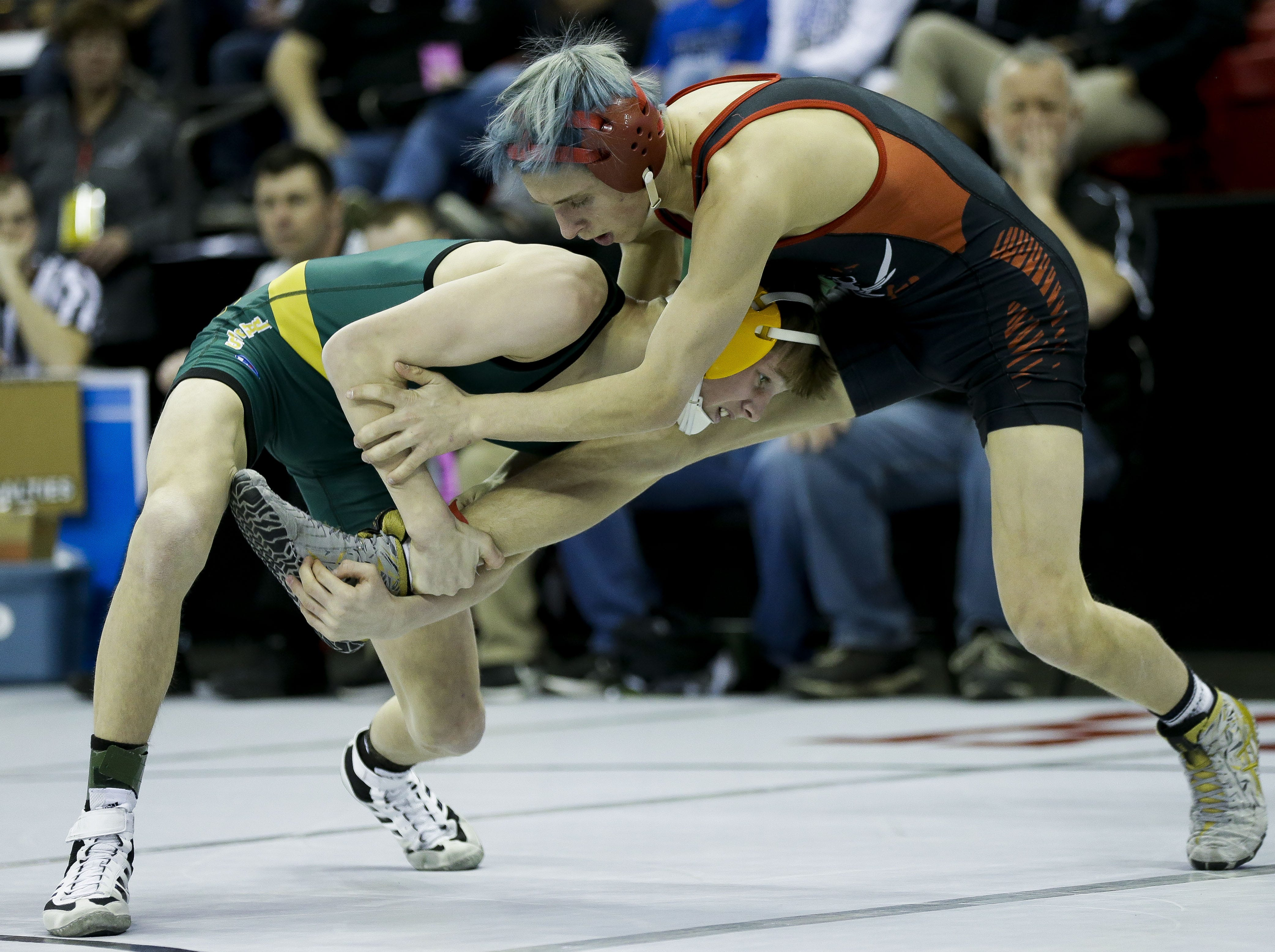 Ashwaubenon's Cody Minor takes down Pewaukee's Rece Czerniejewski in a Division 1 113-pound preliminary match during the WIAA state wrestling tournament on Thursday, February 21, 2019, at the Kohl Center in Madison, Wis. Tork Mason/USA TODAY NETWORK-Wisconsin