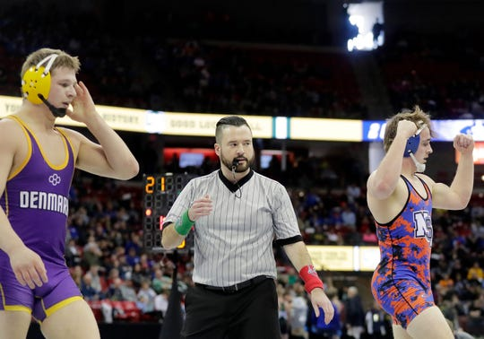North Fond du Lac/St Mary's Springs' Marcus Orlandoni celebrates after defeating Denmark's Gabe Wertel in a Division 2 195-pound quarterfinal match at the WIAA state individual wrestling tournament Friday at the Kohl Center in Madison.