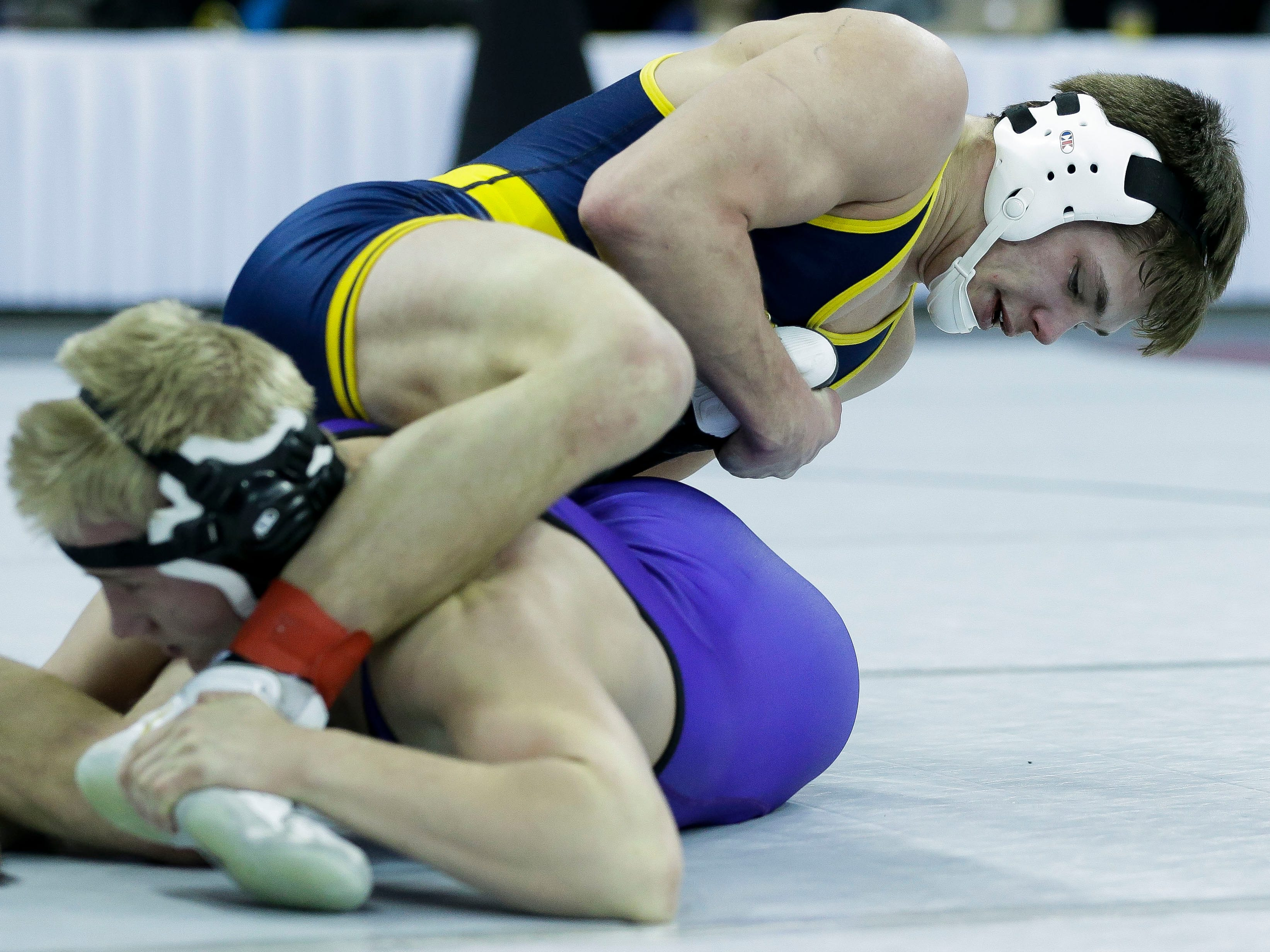 Chilton/Hilbert's Gaven Lisowe fights for position against Ellsworth's Sawyer Hamilton in a Division 2 152-pound preliminary match during the WIAA state wrestling tournament on Thursday, February 21, 2019, at the Kohl Center in Madison, Wis.