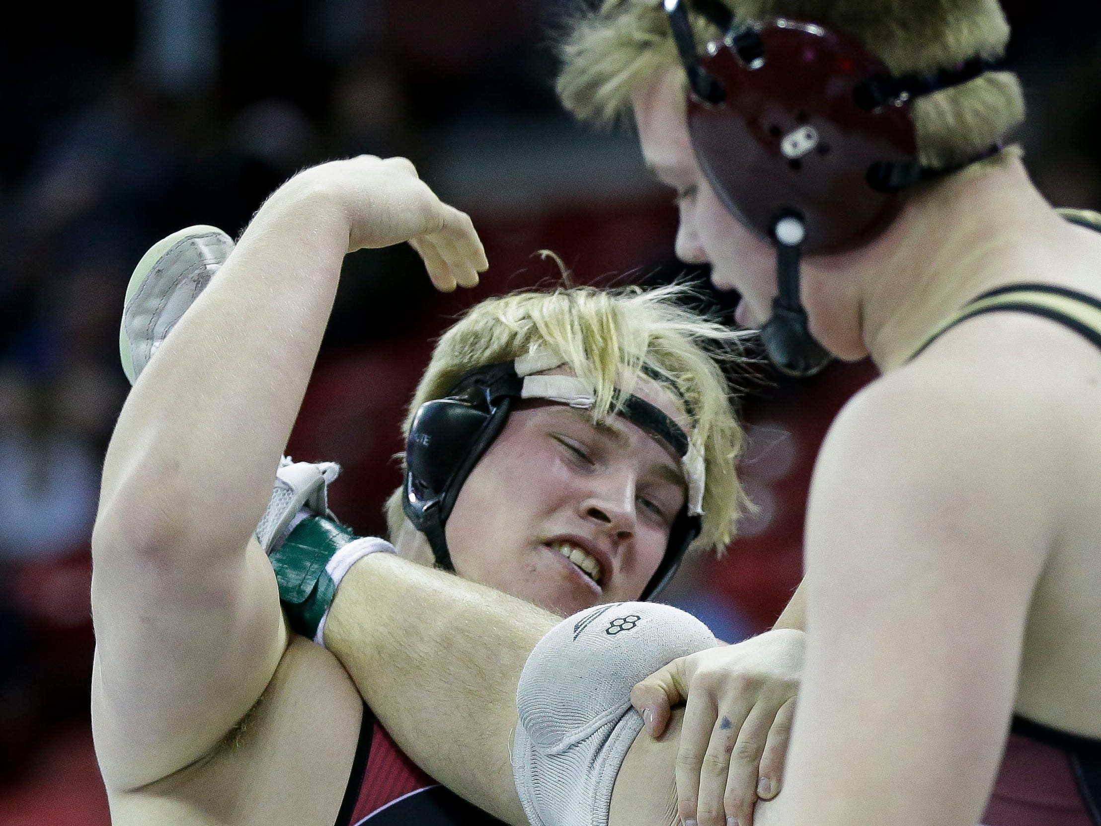 Medford's Jake Rau works to take down Gale-Ettrick-Trempealeau/Melrose-Mindoro's Trevor Daffinson in a Division 2 220-pound preliminary match during the WIAA state wrestling tournament on Thursday, February 21, 2019, at the Kohl Center in Madison, Wis.