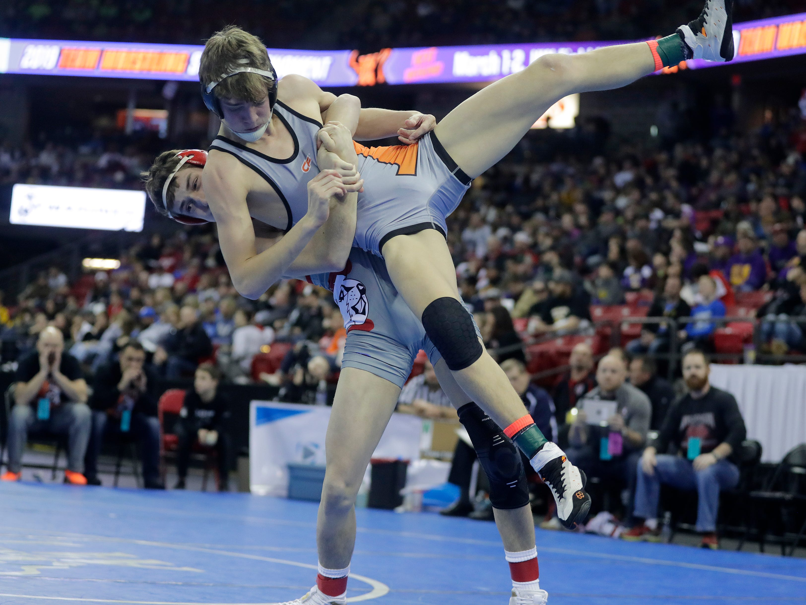 Cedar Grove-Belgium's Quinn Hoopman wrestles Cumberland's Benett Schramski in a Division 3 132-pound preliminary match at the WIAA state individual wrestling tournament at the Kohl Center on Thursday, February 21, 2019 in Madison, Wis.