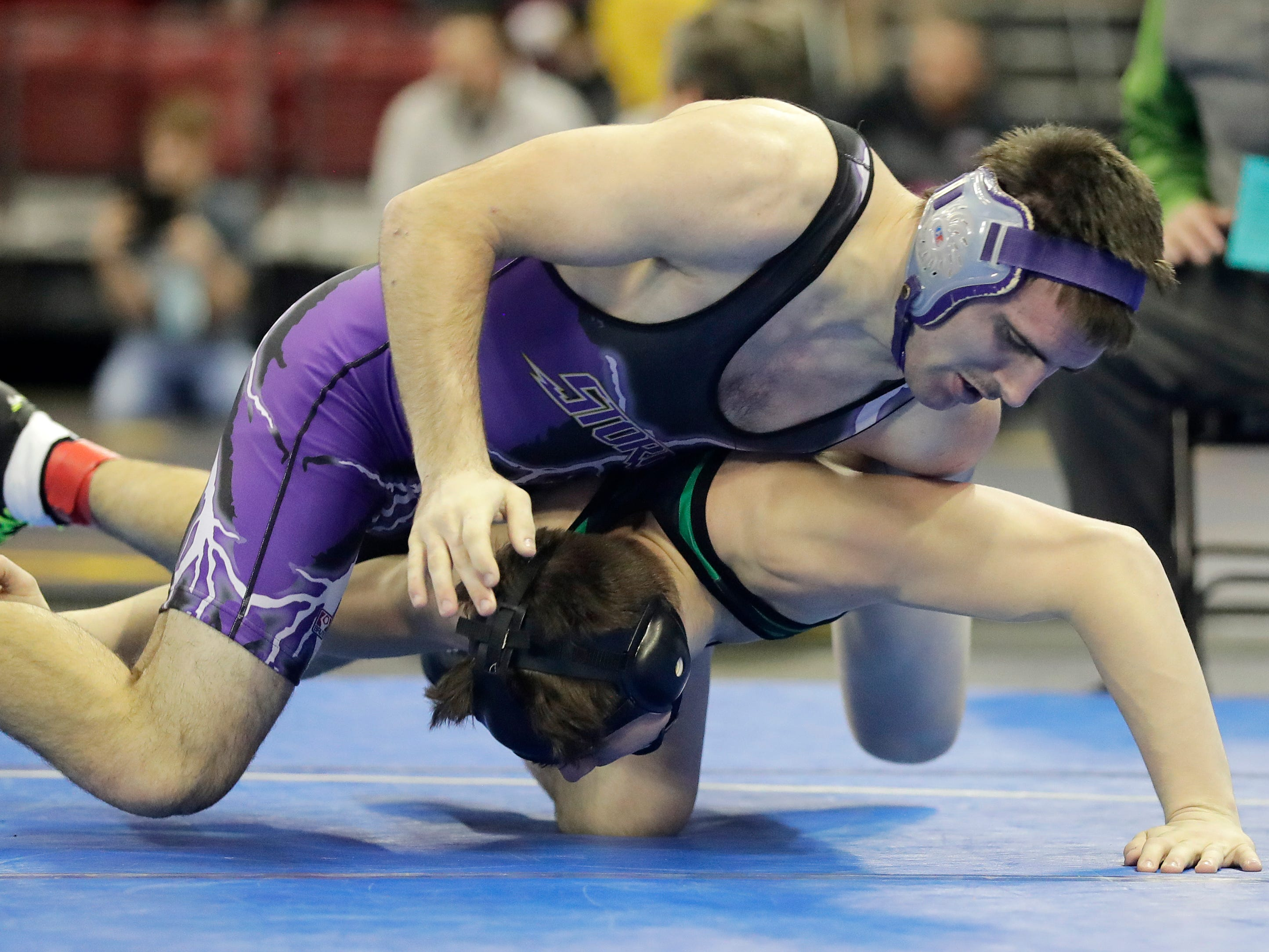 Kewaunee's Travis Reinke wrestles Coleman's Shamus McLain in a Division 3 170-pound preliminary match at the WIAA state individual wrestling tournament at the Kohl Center on Thursday, February 21, 2019 in Madison, Wis.