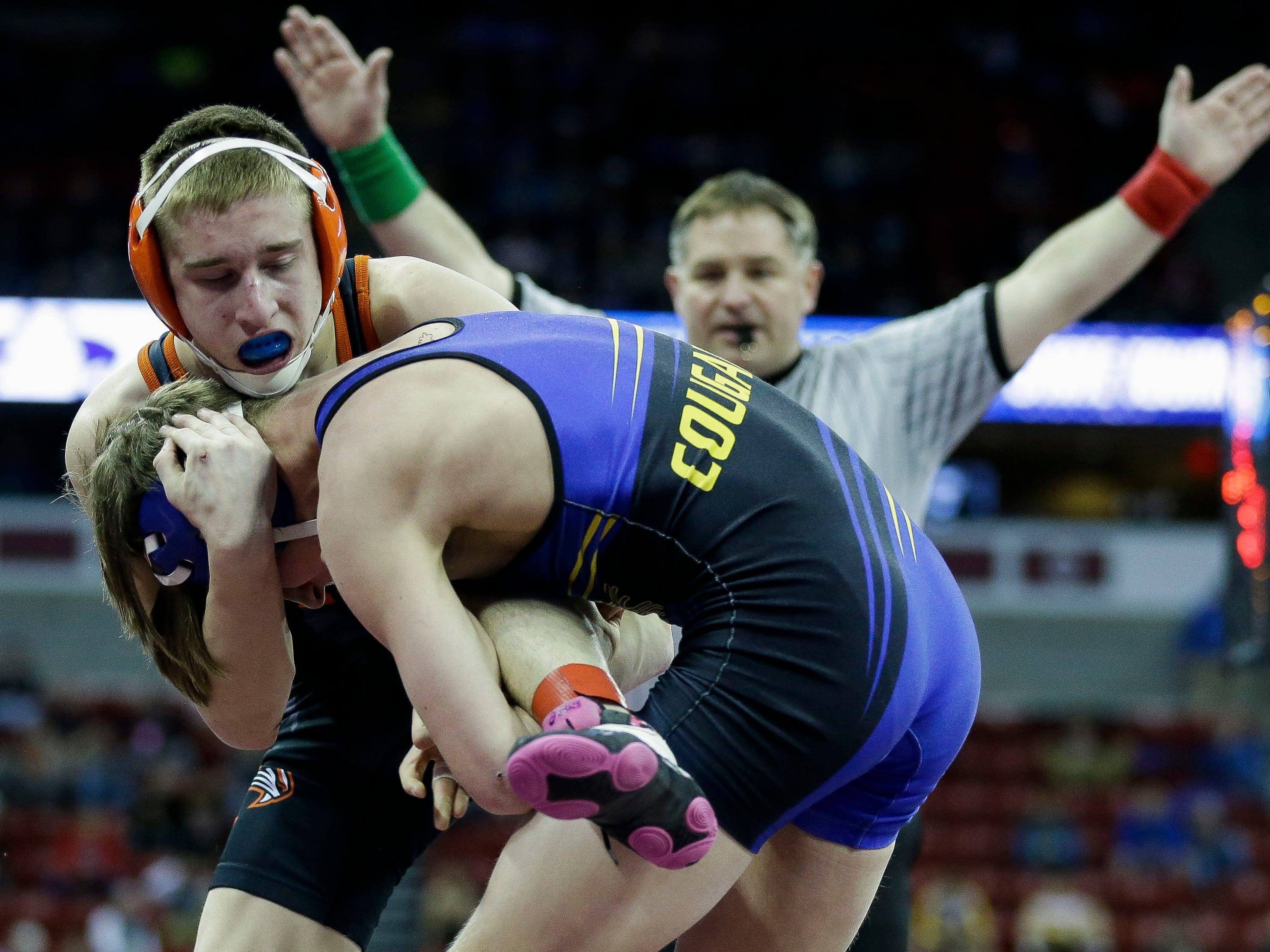 Oconto Falls' Tyler Budz fights to keep his balance against Elkhart Lake-Glenbeulah/Howards Grove's Cody Rebedew in a Division 2 126-pound preliminary match during the WIAA state wrestling tournament on Thursday, February 21, 2019, at the Kohl Center in Madison, Wis.