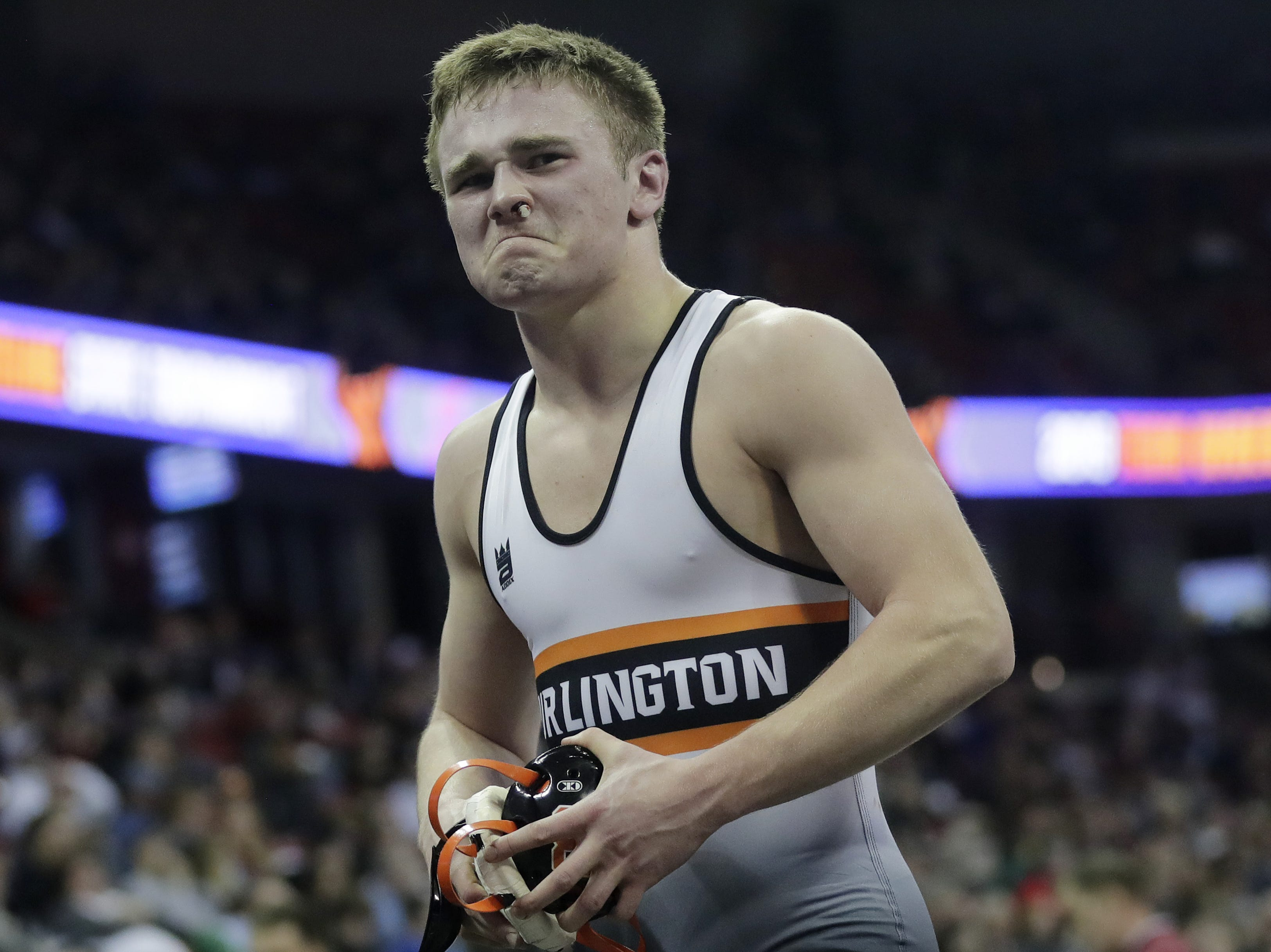 Burlington's Qwade Gehring walks off the mat after losing a Division 1 170-pound preliminary match at the WIAA state individual wrestling tournament at the Kohl Center on Thursday, February 21, 2019 in Madison, Wis. Adam Wesley/USA TODAY NETWORK-Wisconsin