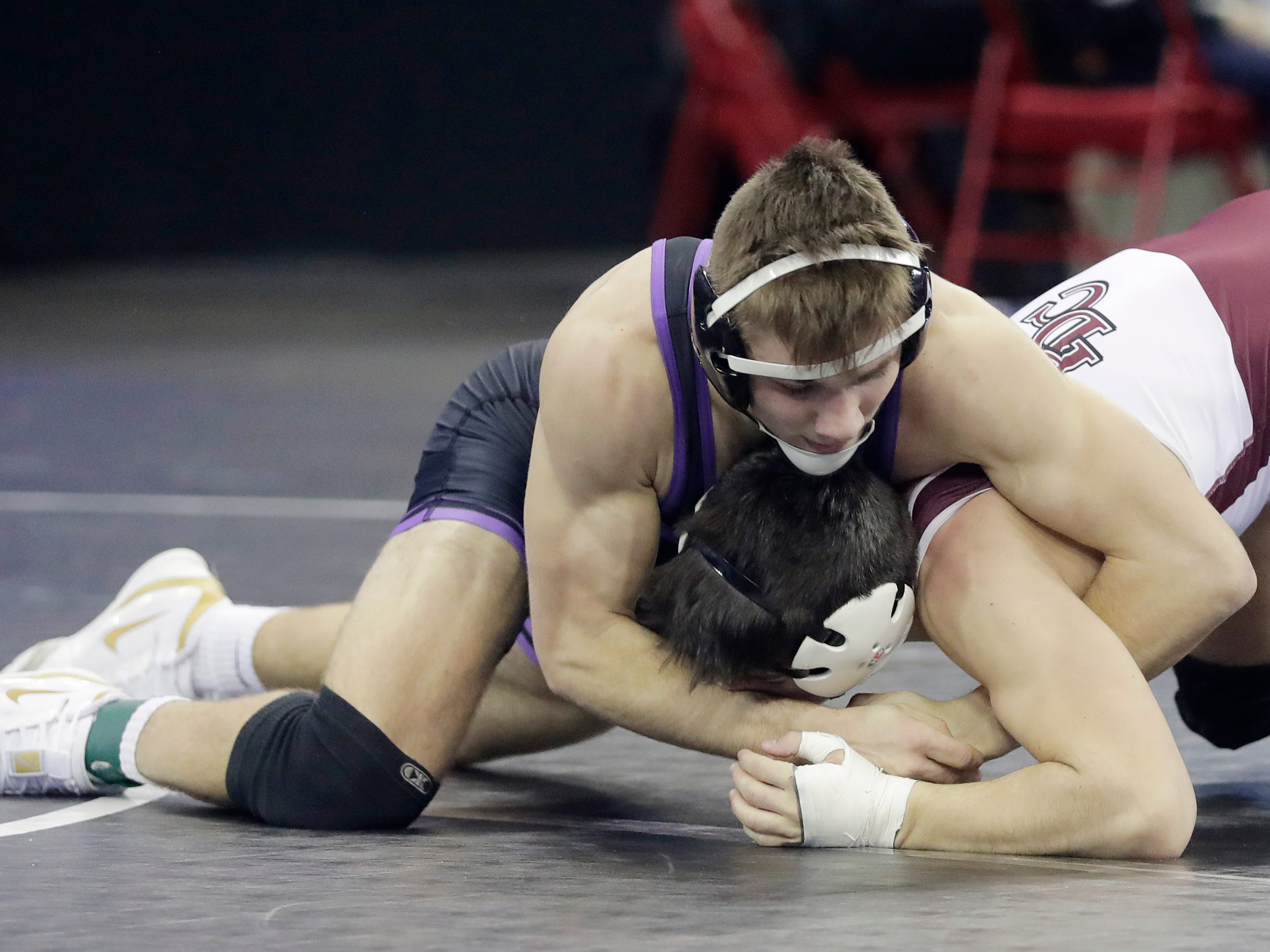 Mosinee's Gage Coppock wrestles in a Division 2 152-pound preliminary match at the WIAA state individual wrestling tournament at the Kohl Center on Thursday, February 21, 2019 in Madison, Wis.