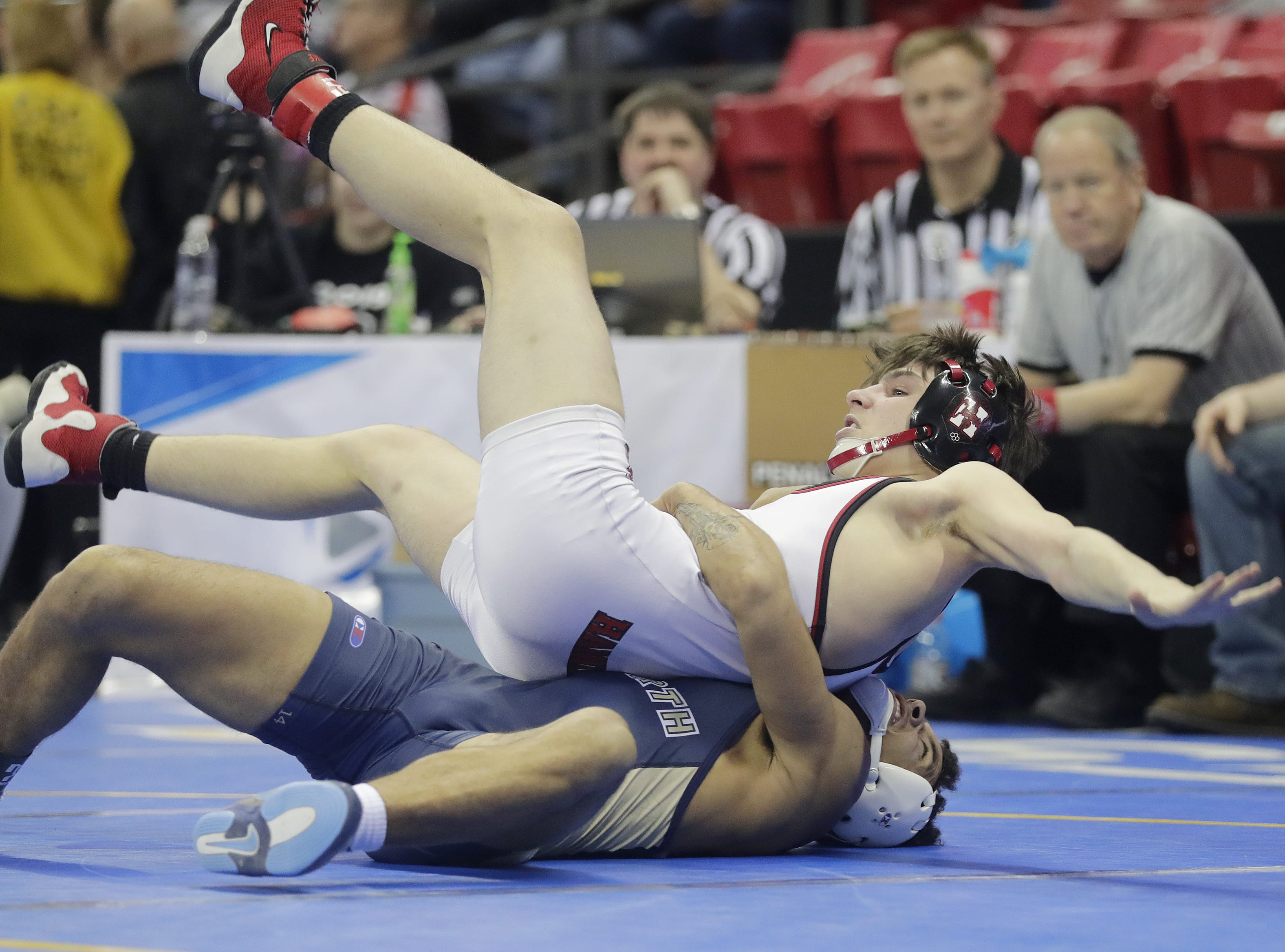 Appleton North's Terrell Williams wrestles Stoughton's Brooks Empey in a Division 1 195-pound preliminary match at the WIAA state individual wrestling tournament at the Kohl Center on Thursday, February 21, 2019 in Madison, Wis. Adam Wesley/USA TODAY NETWORK-Wisconsin