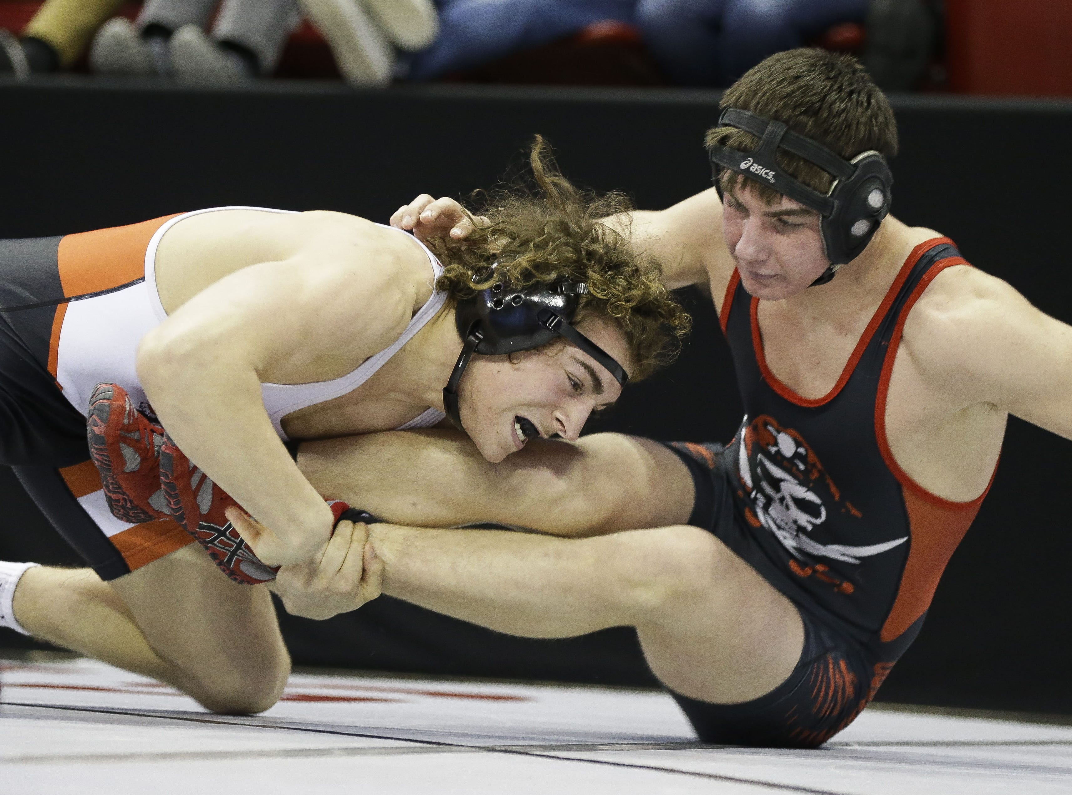 Marshfield's Bentley Schwanebeck-Ostermann takes down Pewaukee's Joe Sklenar in a Division 1 182-pound preliminary match during the WIAA state wrestling tournament on Thursday, February 21, 2019, at the Kohl Center in Madison, Wis. Tork Mason/USA TODAY NETWORK-Wisconsin