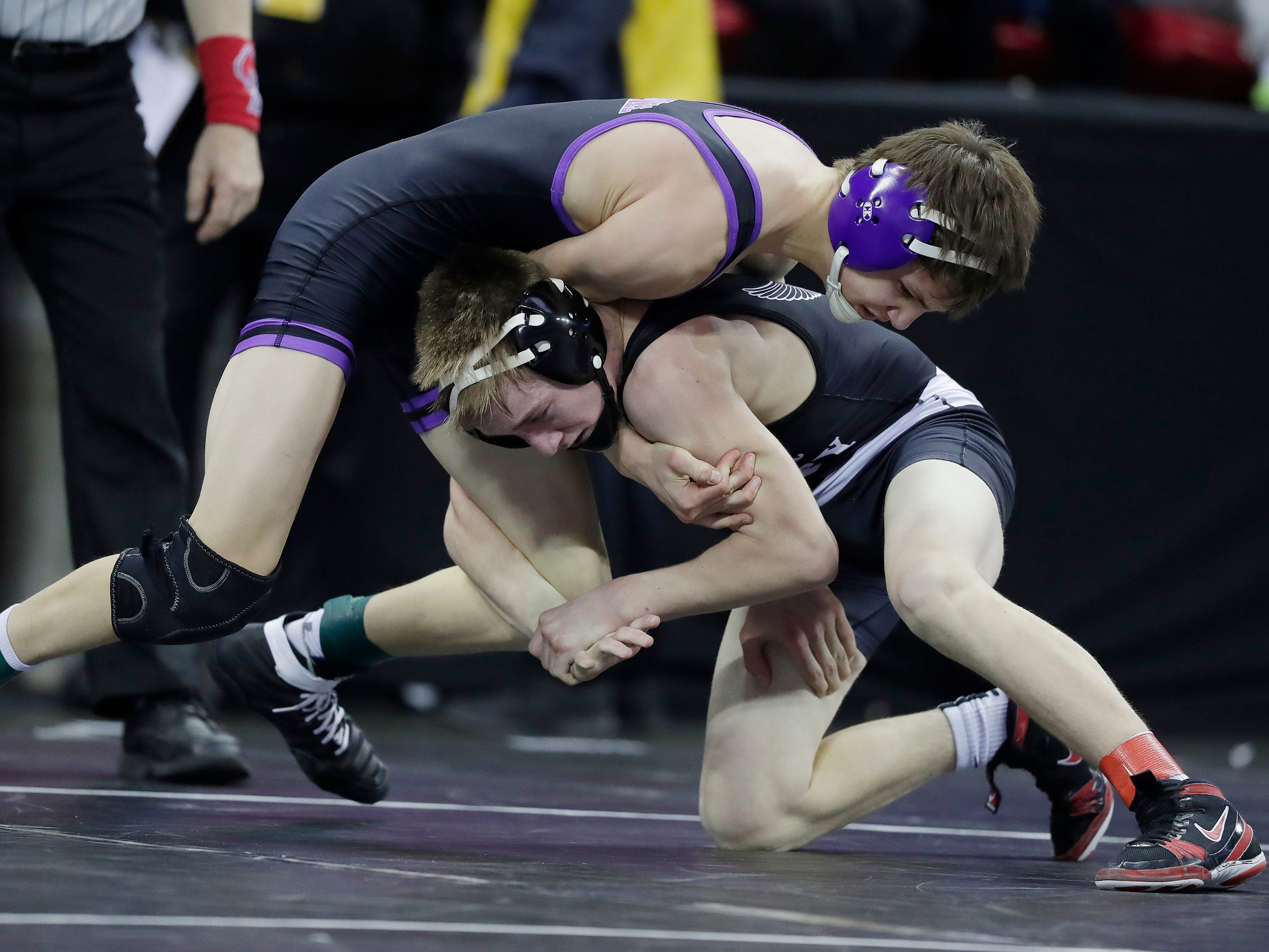Mosinee's Chase Kmosena wrestles River Valley's Jimmy Jennings in a Division 2 113-pound preliminary match at the WIAA state individual wrestling tournament at the Kohl Center on Thursday, February 21, 2019 in Madison, Wis.