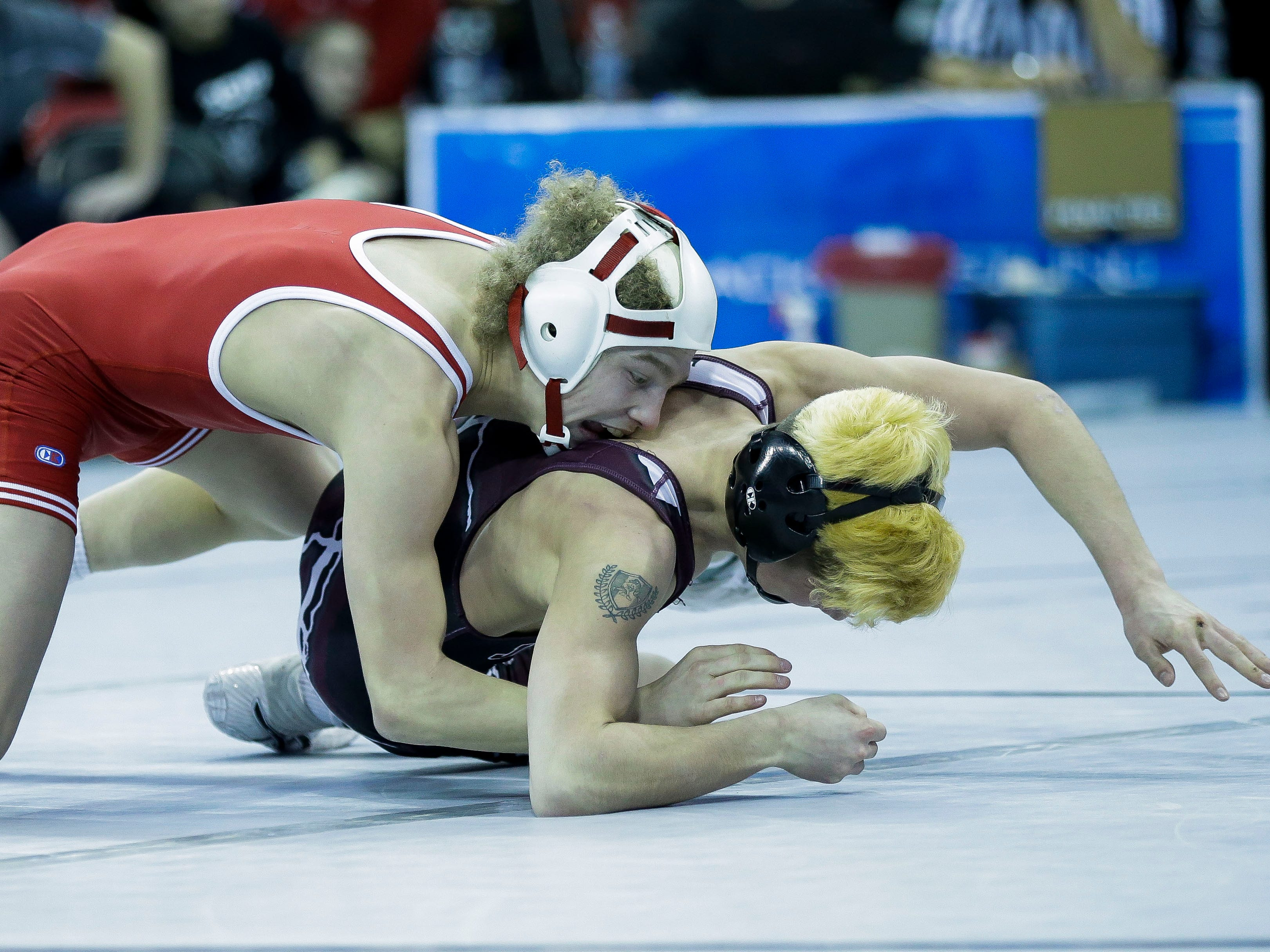 Spencer/Columbus Catholic's Treyton Ackman wrestles against Jefferson's Quintin Gehrmann in a Division 2 113-pound preliminary match during the WIAA state wrestling tournament on Thursday, February 21, 2019, at the Kohl Center in Madison, Wis.