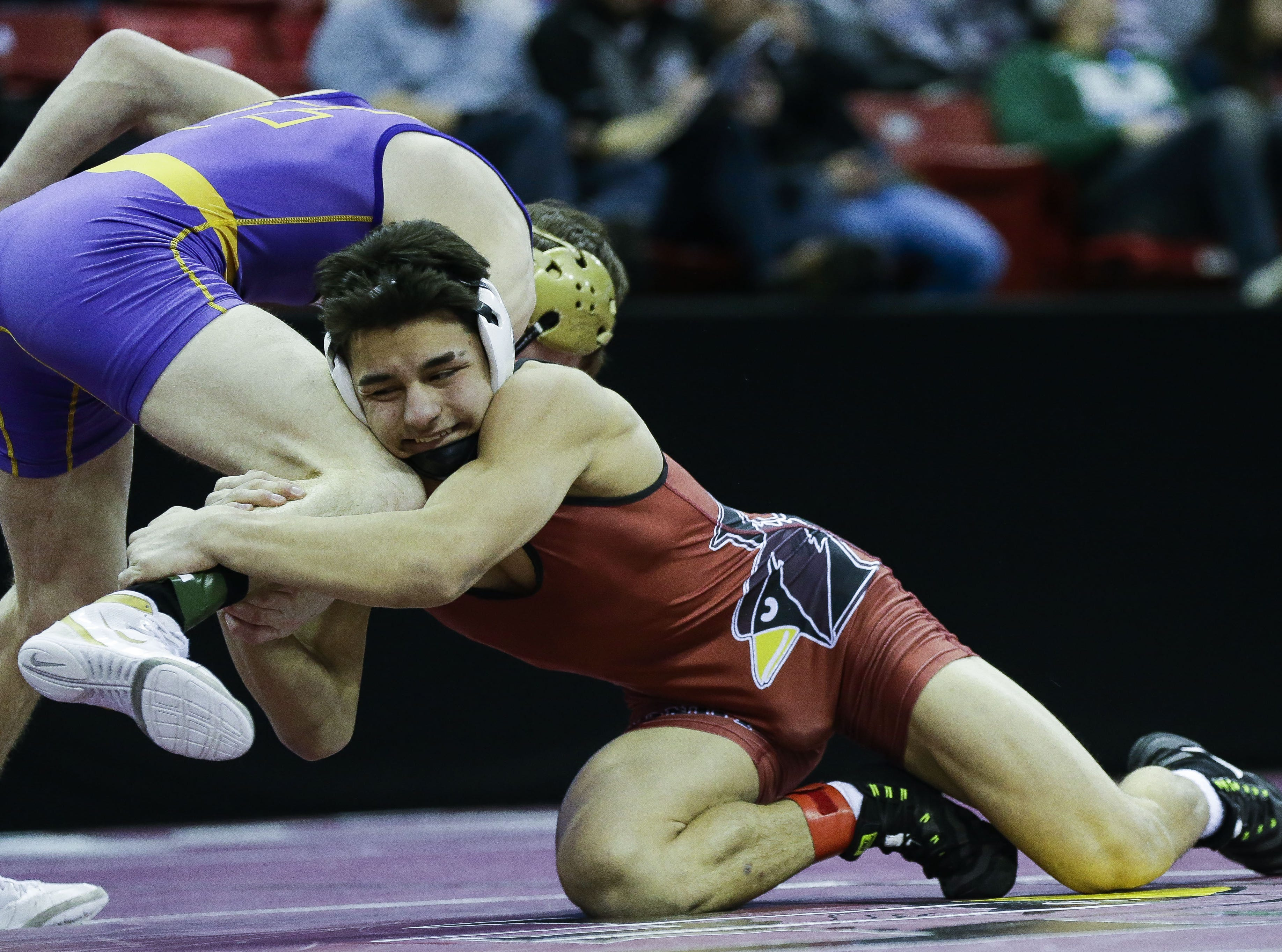 Fond du Lac's Issac Ortegon wrestles against Elkhorn Area/Faith Christian's Daniel Stilling in a Division 1 138-pound preliminary match during the WIAA state wrestling tournament on Thursday, February 21, 2019, at the Kohl Center in Madison, Wis. Tork Mason/USA TODAY NETWORK-Wisconsin