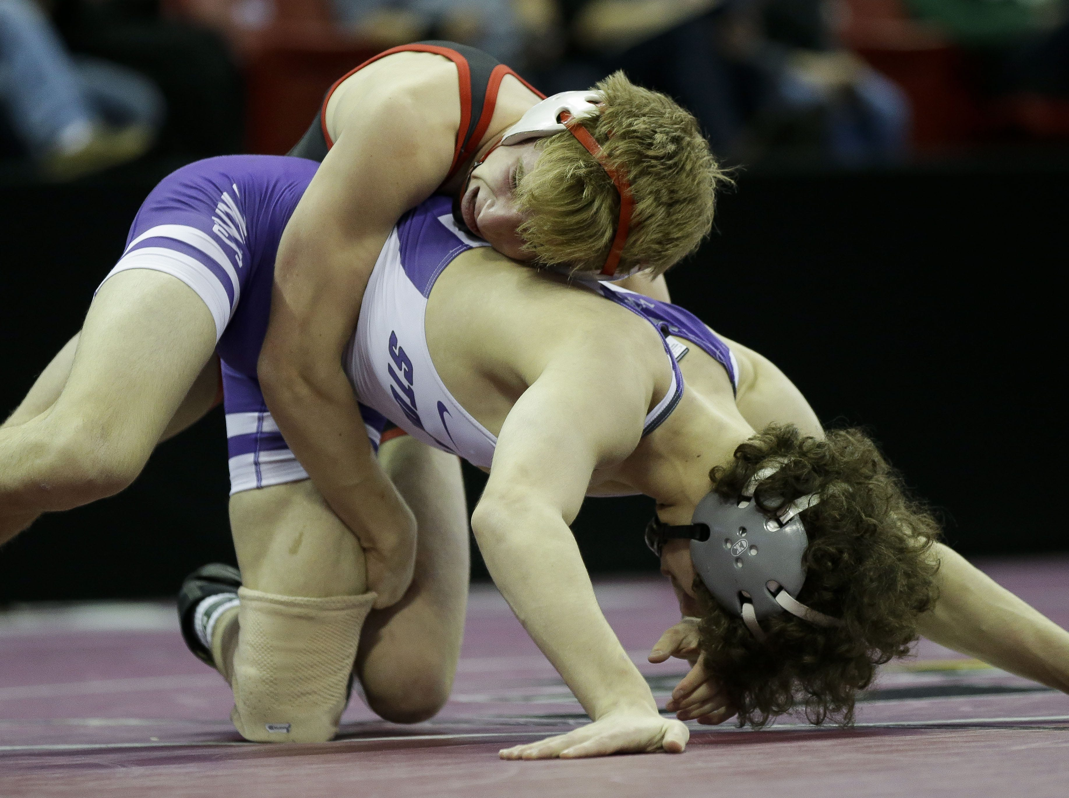 Kimberly's Max Sanderfoot wrestles against Stoughton's Braeden Whitehead in a Division 1 132-pound preliminary match during the WIAA state wrestling tournament on Thursday, February 21, 2019, at the Kohl Center in Madison, Wis. Tork Mason/USA TODAY NETWORK-Wisconsin
