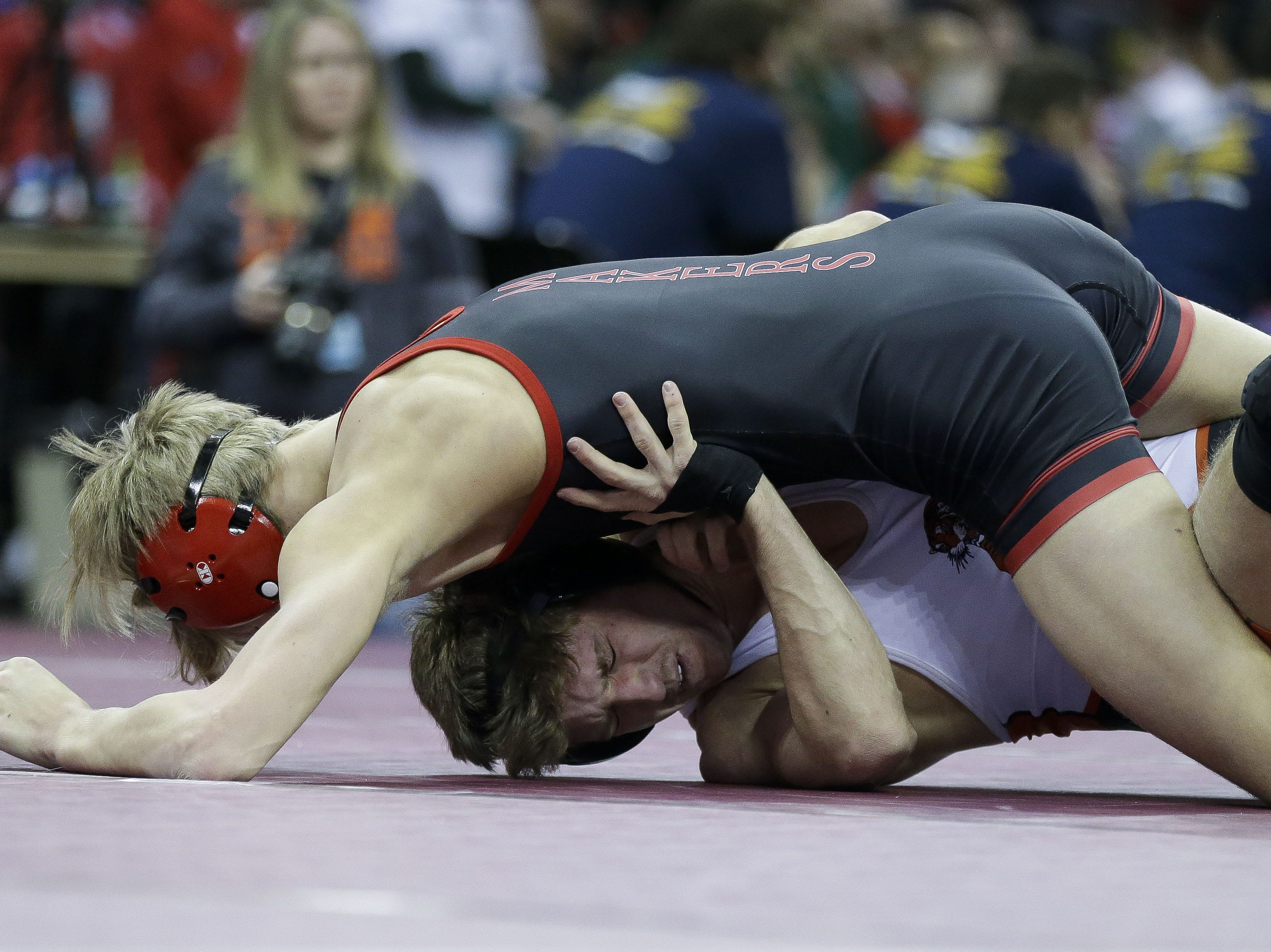 Marshfield's Caden Pearce scrambles against Kimberly's Tucker Smith in a Division 1 145-pound preliminary match during the WIAA state wrestling tournament on Thursday, February 21, 2019, at the Kohl Center in Madison, Wis. Tork Mason/USA TODAY NETWORK-Wisconsin