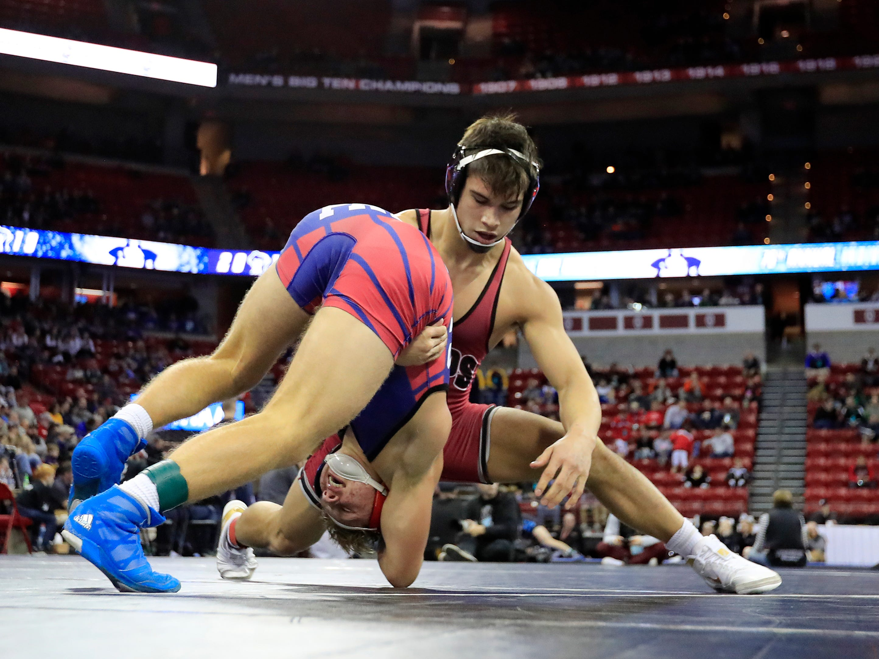 Appleton East's Tyler Locke wrestles Middleton's Kevin Meicher in a Division 1 152-pound quarterfinal match at the WIAA state individual wrestling tournament at the Kohl Center on Thursday, February 21, 2019 in Madison, Wis.