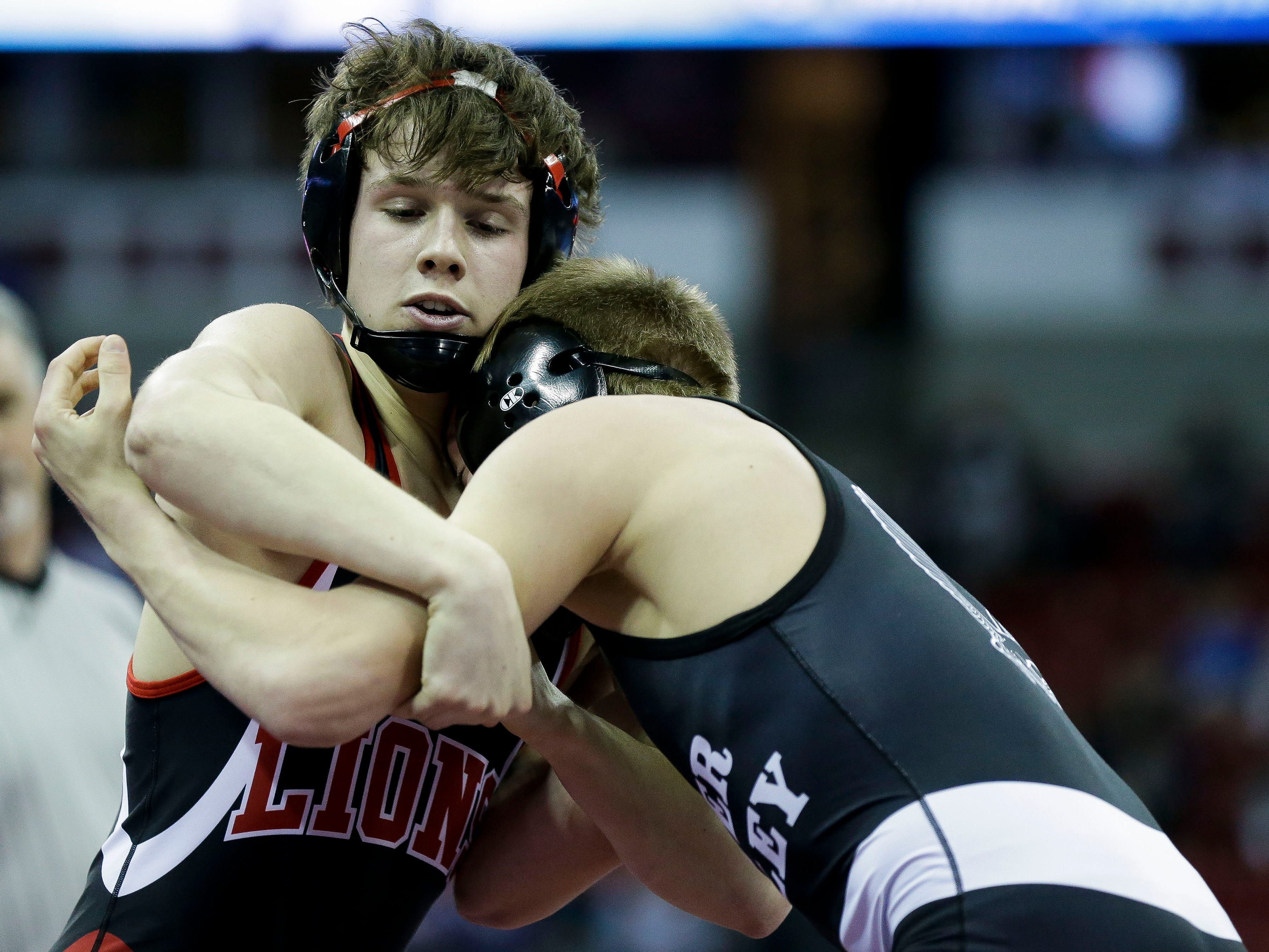 Lomira's Adam Sauer wrestles against River Valley's Devan Alt in a Division 2 138-pound preliminary match during the WIAA state wrestling tournament on Thursday, February 21, 2019, at the Kohl Center in Madison, Wis.