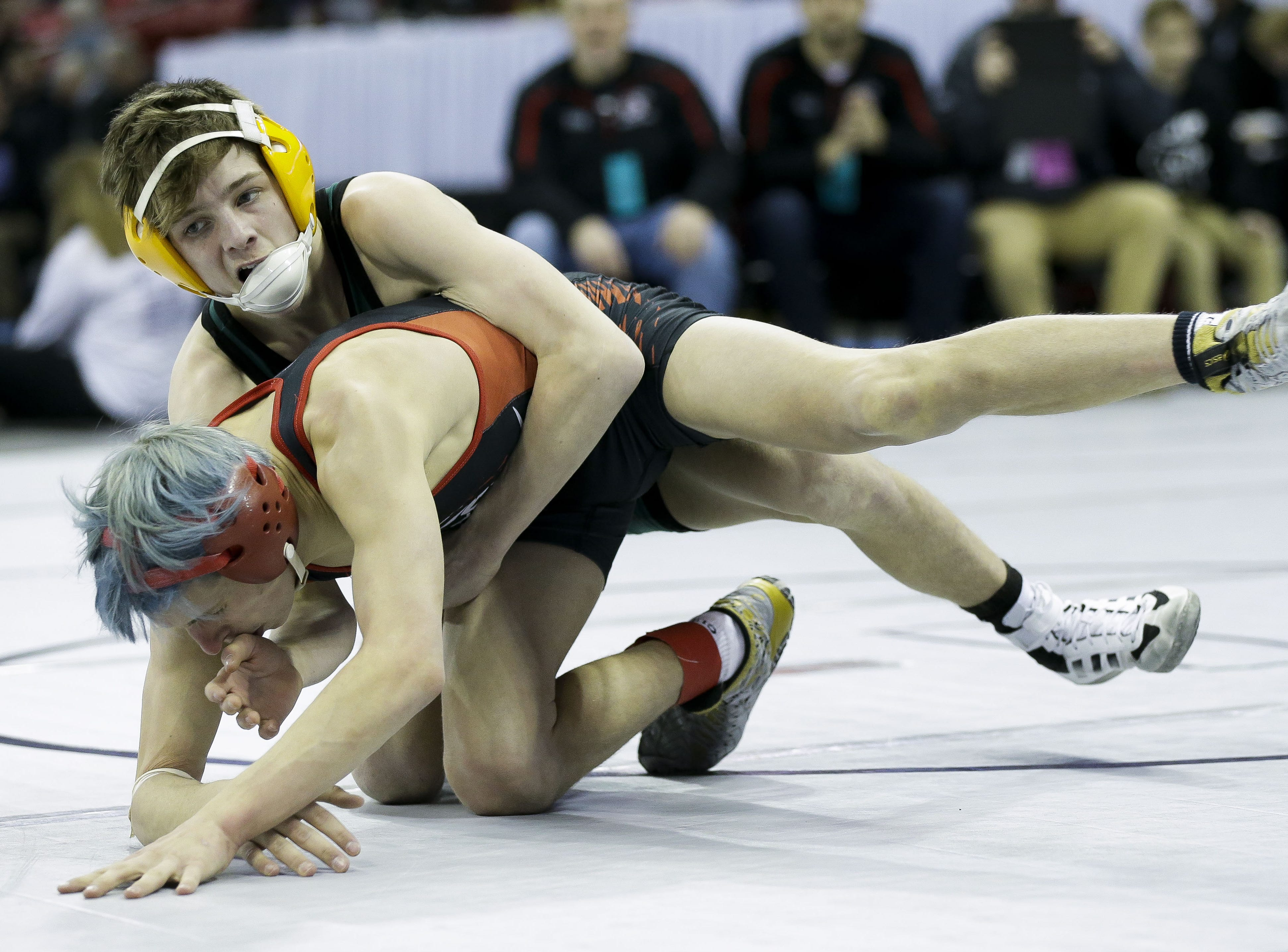 Ashwaubenon's Cody Minor wrestles against Pewaukee's Rece Czerniejewski in a Division 1 113-pound preliminary match during the WIAA state wrestling tournament on Thursday, February 21, 2019, at the Kohl Center in Madison, Wis. Tork Mason/USA TODAY NETWORK-Wisconsin