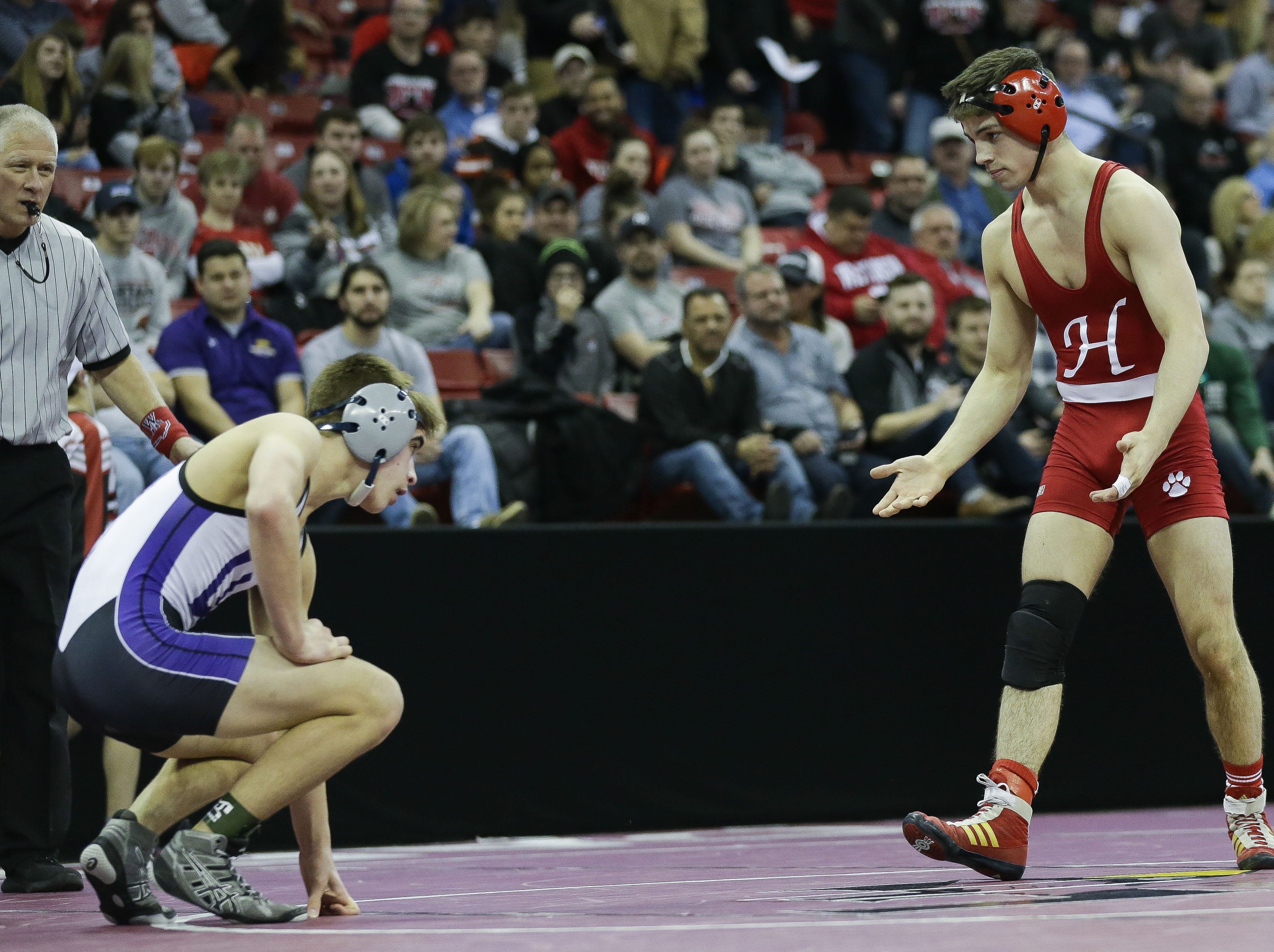 Hortonville's Eric Barnett gestures to Waunakee's Berhett Statz in a Division 1 126-pound preliminary match during the WIAA state wrestling tournament on Thursday, February 21, 2019, at the Kohl Center in Madison, Wis. Tork Mason/USA TODAY NETWORK-Wisconsin