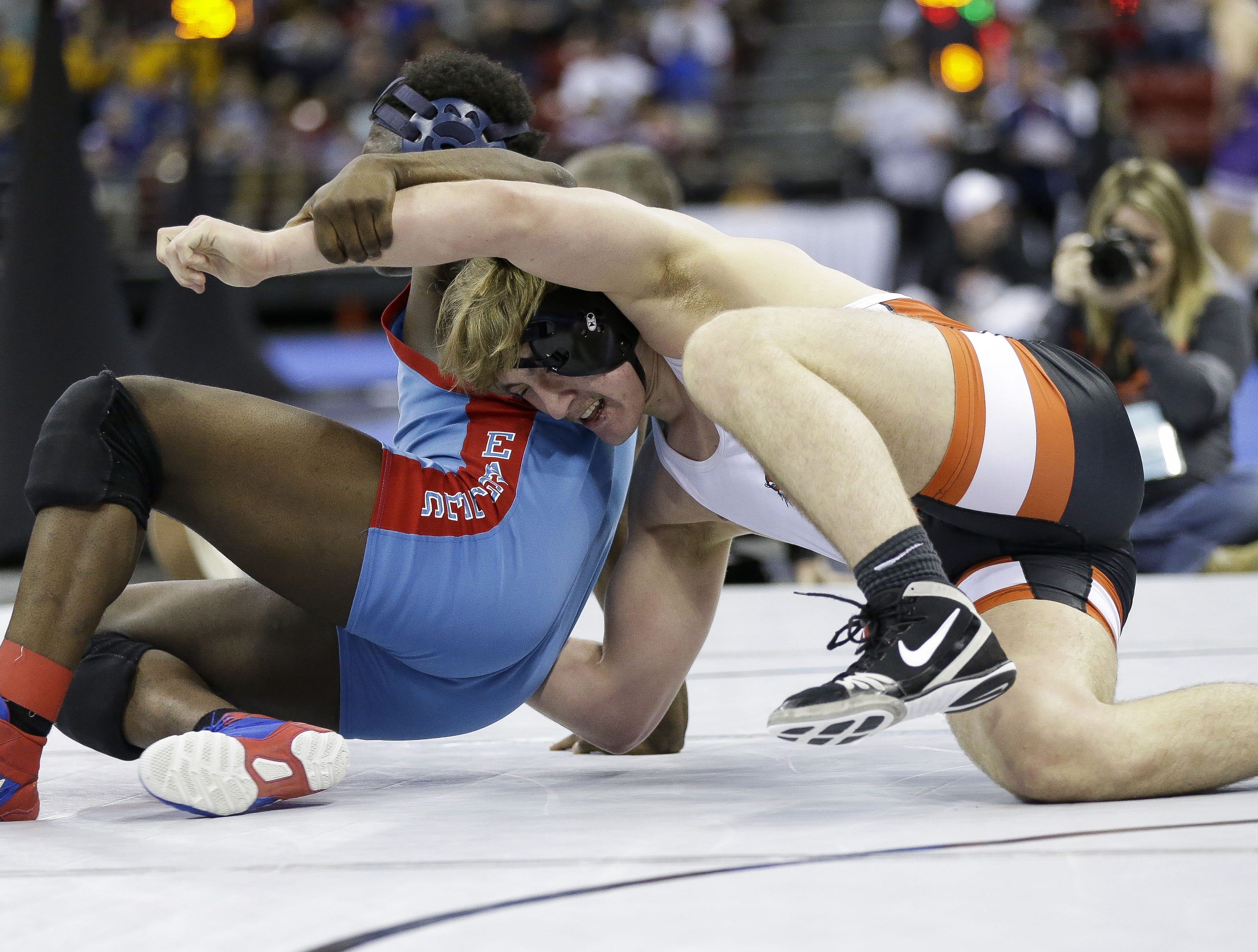Marshfield's Sam Mitchell wrestles against Milwaukee Morse-Marshall's Azarion Waits in a Division 1 195-pound preliminary match during the WIAA state wrestling tournament on Thursday, February 21, 2019, at the Kohl Center in Madison, Wis. Tork Mason/USA TODAY NETWORK-Wisconsin