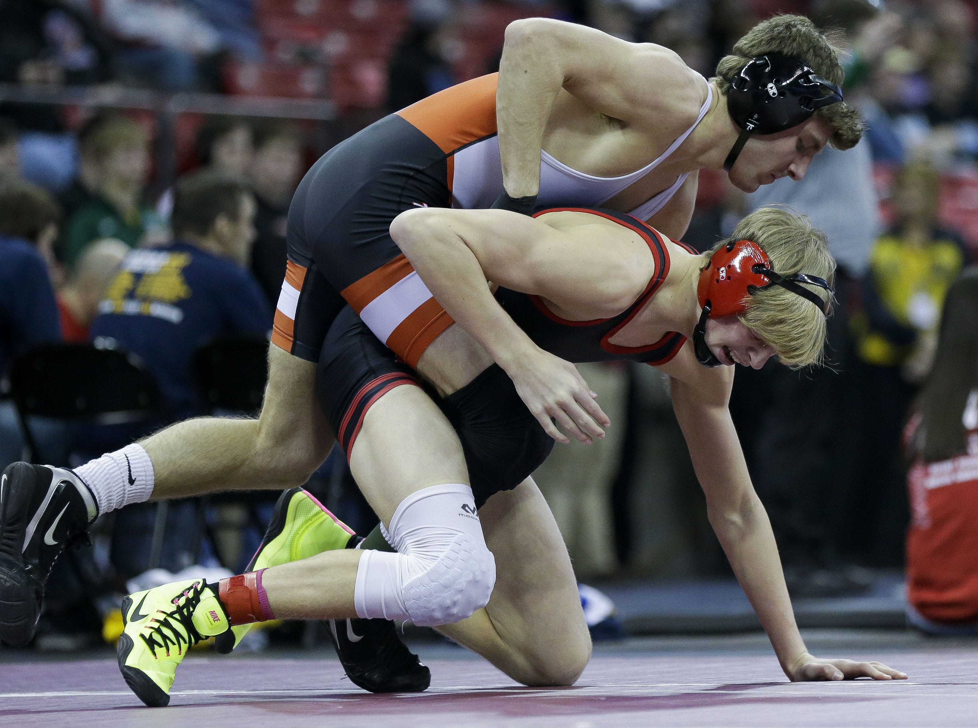 Marshfield's Caden Pearce wrestles against Kimberly's Tucker Smith in a Division 1 145-pound preliminary match during the WIAA state wrestling tournament on Thursday, February 21, 2019, at the Kohl Center in Madison, Wis. Tork Mason/USA TODAY NETWORK-Wisconsin