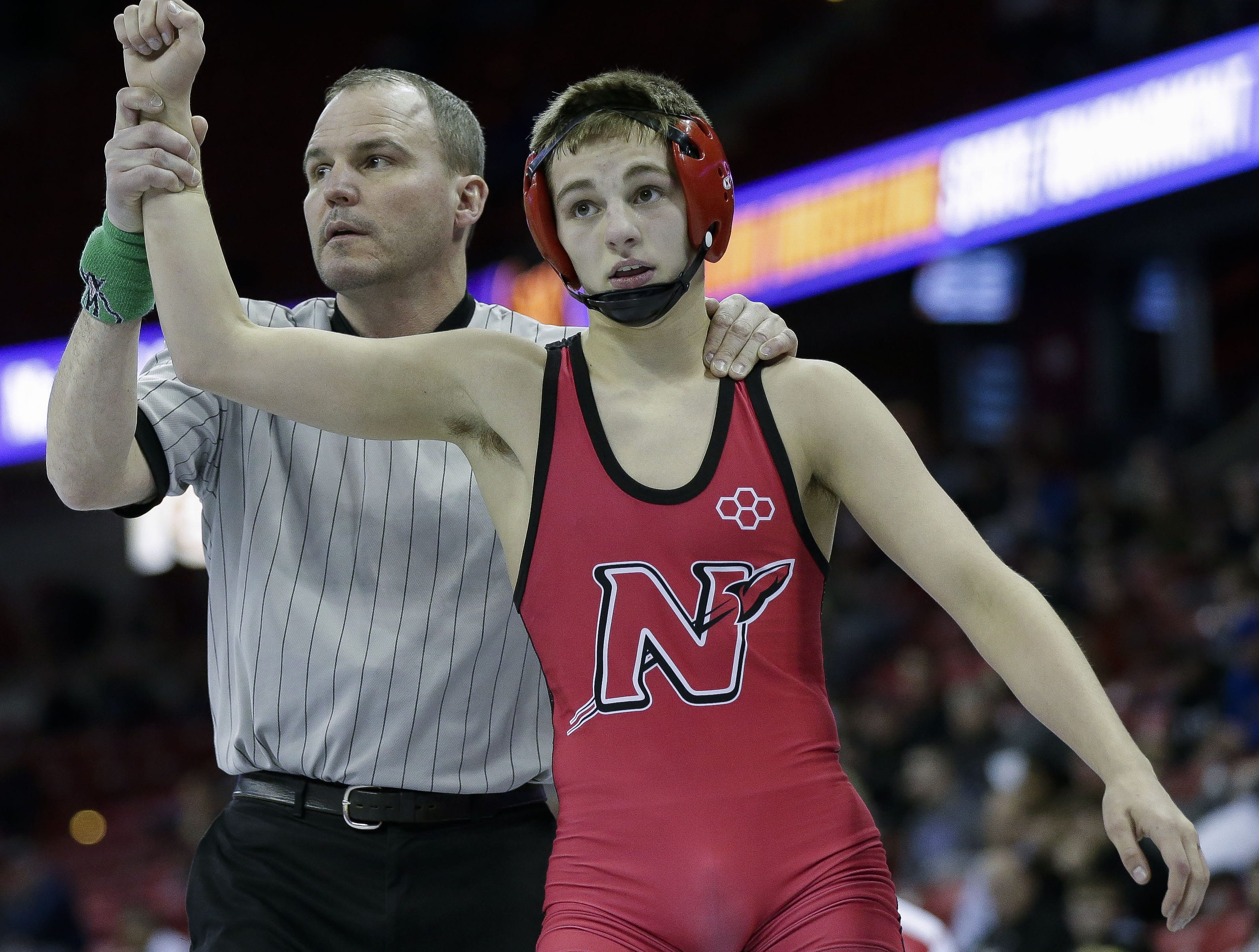 Neenah's Drake Hayward is declared the winner of a Division 1 126-pound preliminary match during the WIAA state wrestling tournament on Thursday, February 21, 2019, at the Kohl Center in Madison, Wis. Tork Mason/USA TODAY NETWORK-Wisconsin