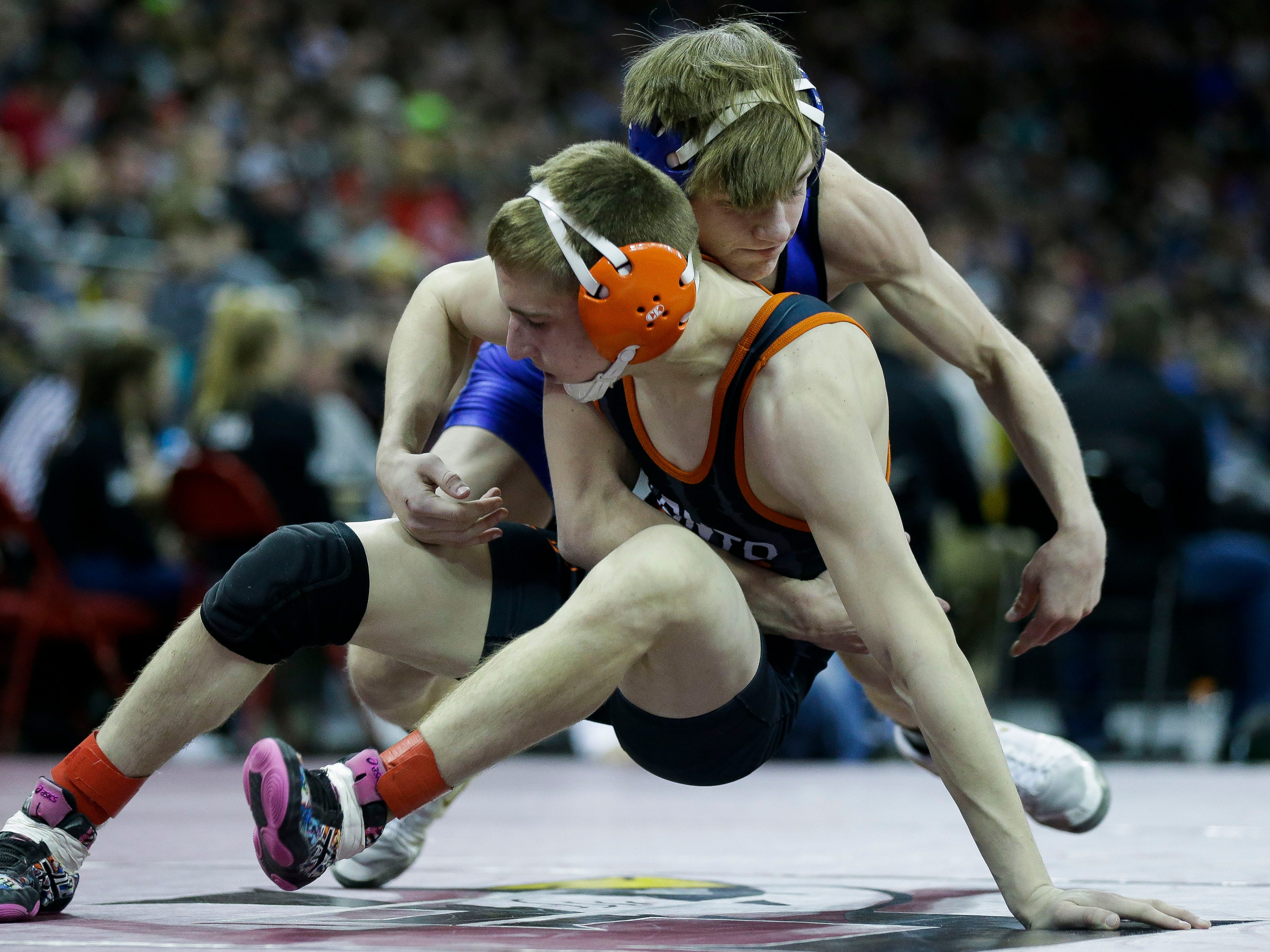 Elkhart Lake-Glenbeulah/Howards Grove's Cody Rebedew wrestles against Oconto Falls' Tyler Budz in a Division 2 126-pound preliminary match during the WIAA state wrestling tournament on Thursday, February 21, 2019, at the Kohl Center in Madison, Wis.