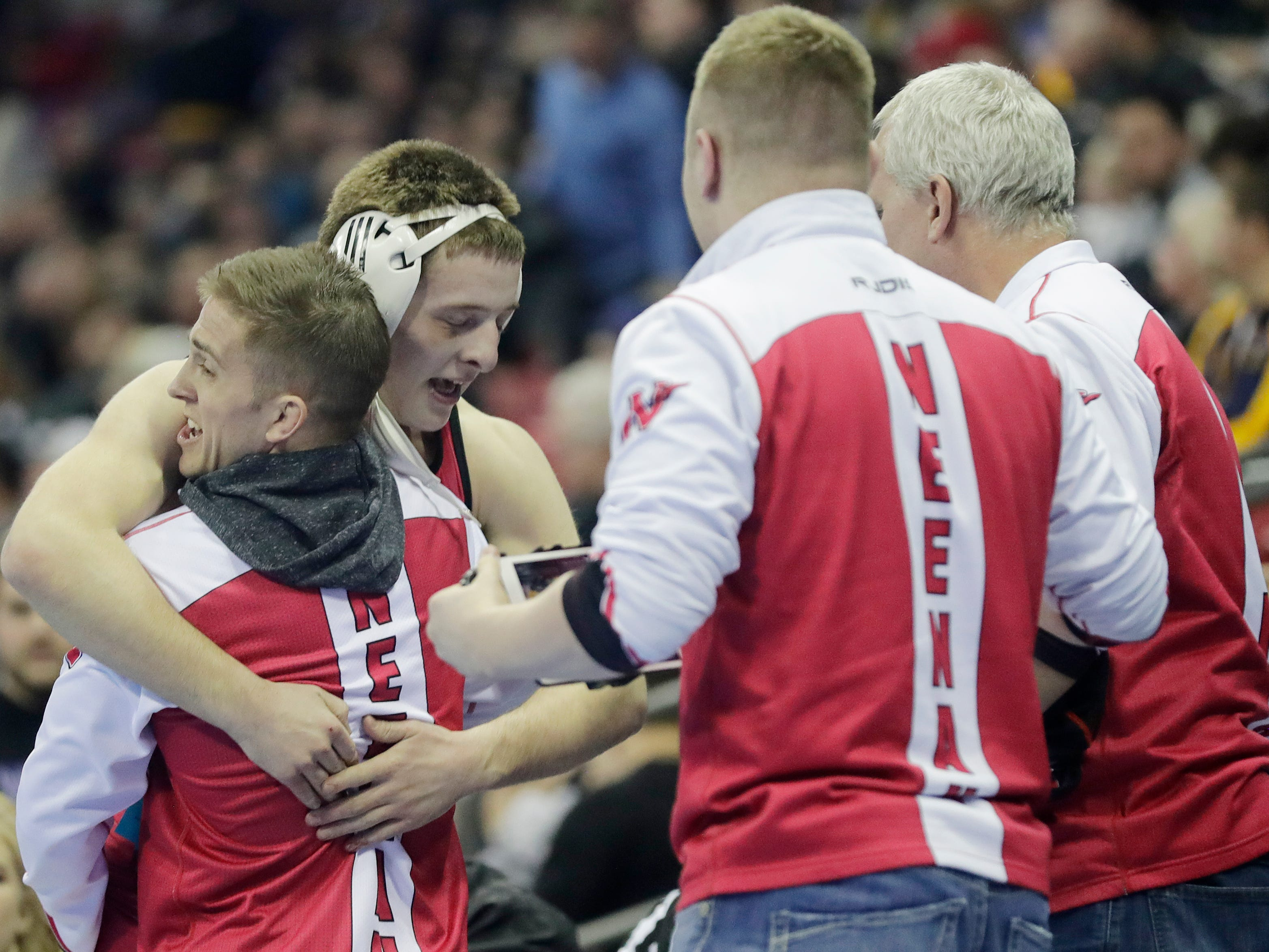 Neenah's Isaiah McCormick reacts after winning a Division 1 170-pound quarterfinal match at the WIAA state individual wrestling tournament at the Kohl Center on Thursday, February 21, 2019 in Madison, Wis.