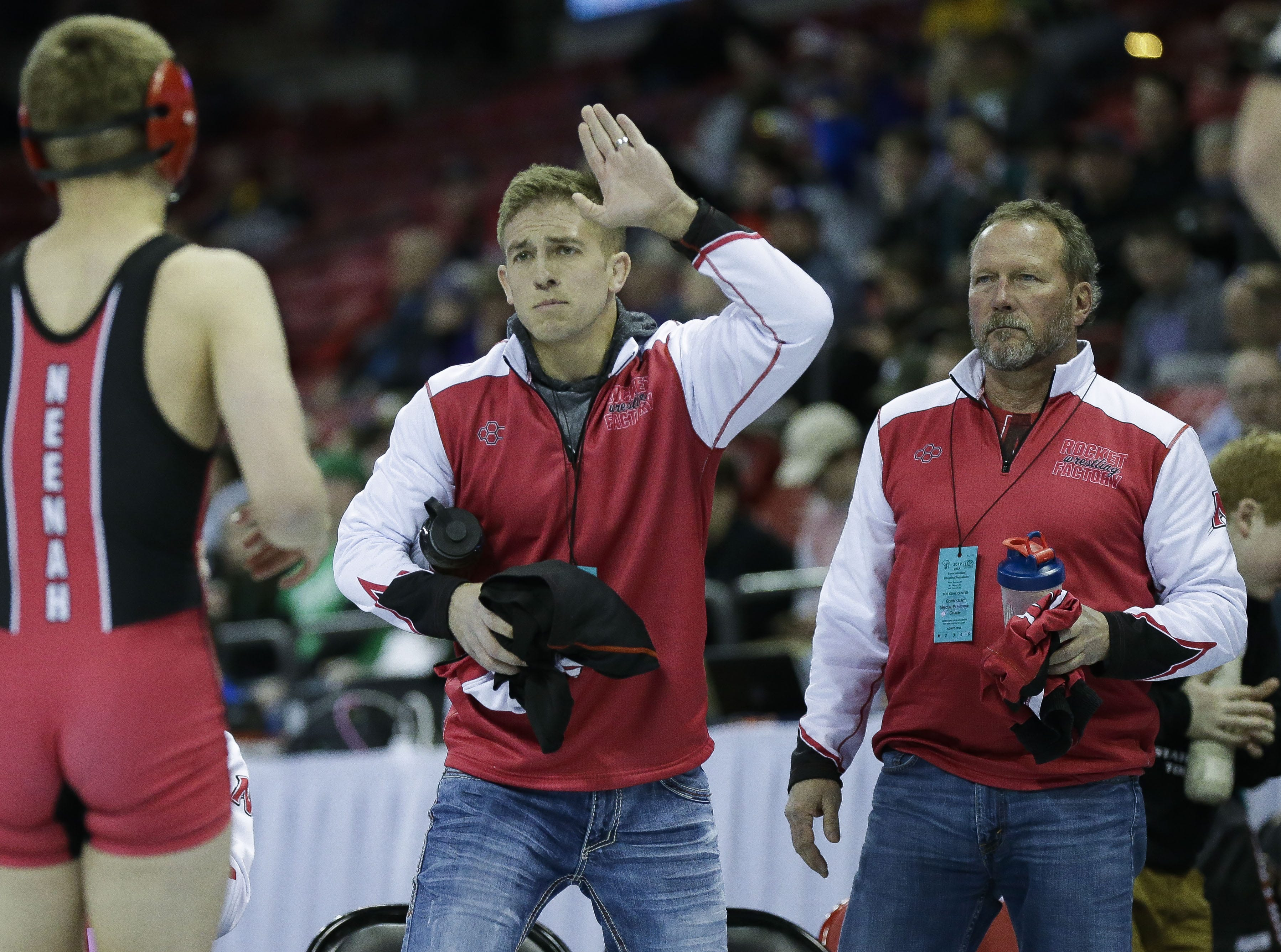 Neenah coaches congratulate Neenah's Drake Hayward after his win in a Division 1 126-pound preliminary match during the WIAA state wrestling tournament on Thursday, February 21, 2019, at the Kohl Center in Madison, Wis. Tork Mason/USA TODAY NETWORK-Wisconsin