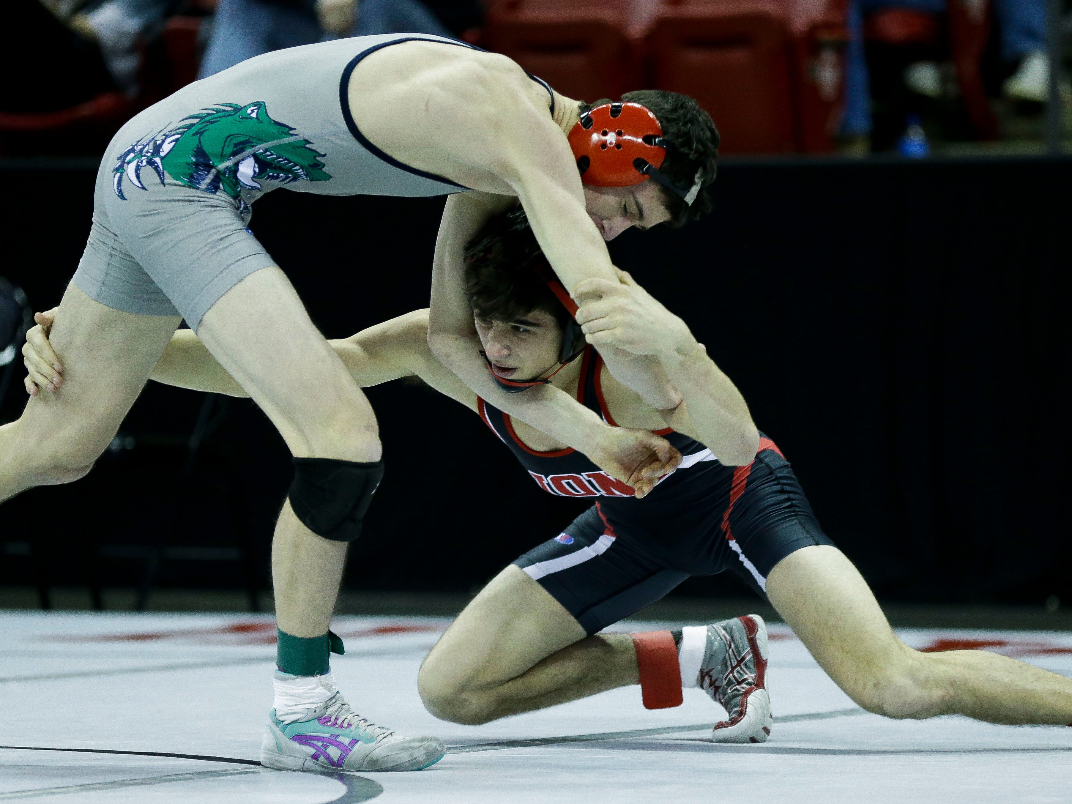 Lomira's Alex Gundrum wrestles against Bloomer/Colfax's Sawyer Best in a Division 2 132-pound preliminary match during the WIAA state wrestling tournament on Thursday, February 21, 2019, at the Kohl Center in Madison, Wis.