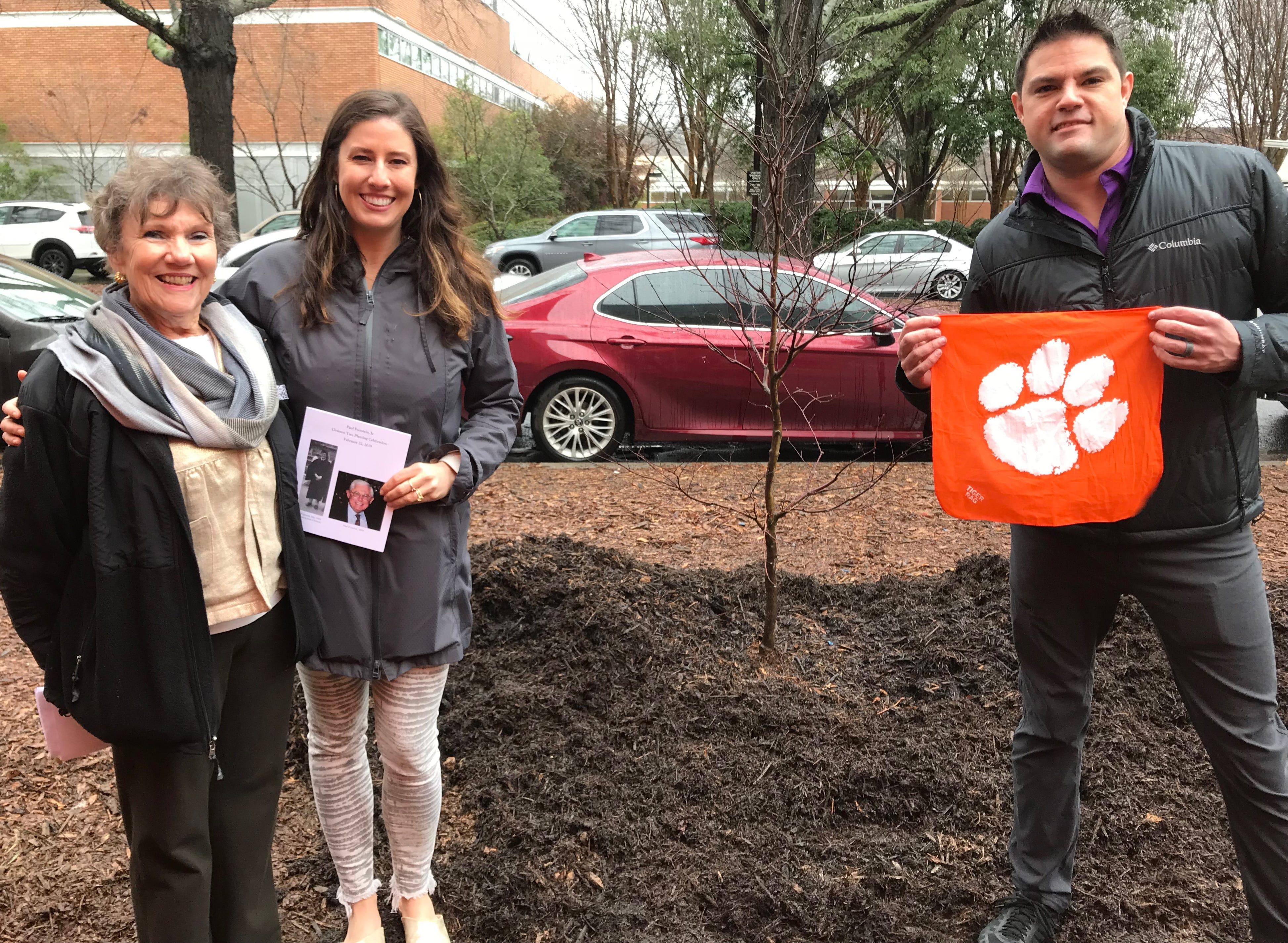 Jane Archer Feinstein, Sarah Jane Feinstein Brynestad and David Scott Feinstein stand by a newly planted tree on Clemson's campus.