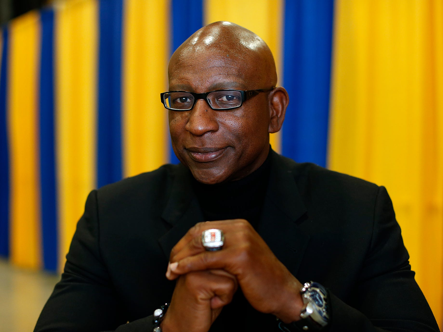 Football great Eric Dickerson poses for a photograph before speaking at the annual Triangle Classic banquet at the Four Seasons Arena Friday. TRIBUNE PHOTO/LARRY BECKNER
