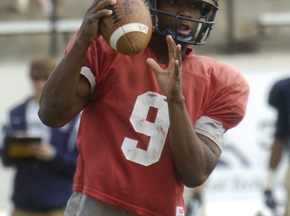 Montana State University quarterback DeNarius McGhee pump fakes during the Triangle Classic scrimmage Saturday at Memorial Stadium.