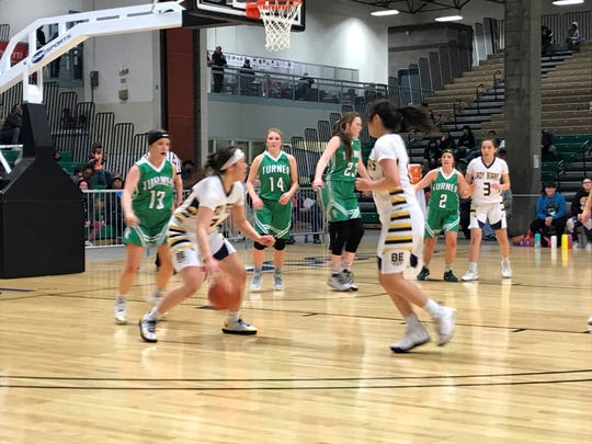 Joelnell Momberg of Box Elder looks for a teammate to pass to during Northern C semifinal action against Turner Thursday night at Pacific Steel and Recycling Four Seasons Arena.