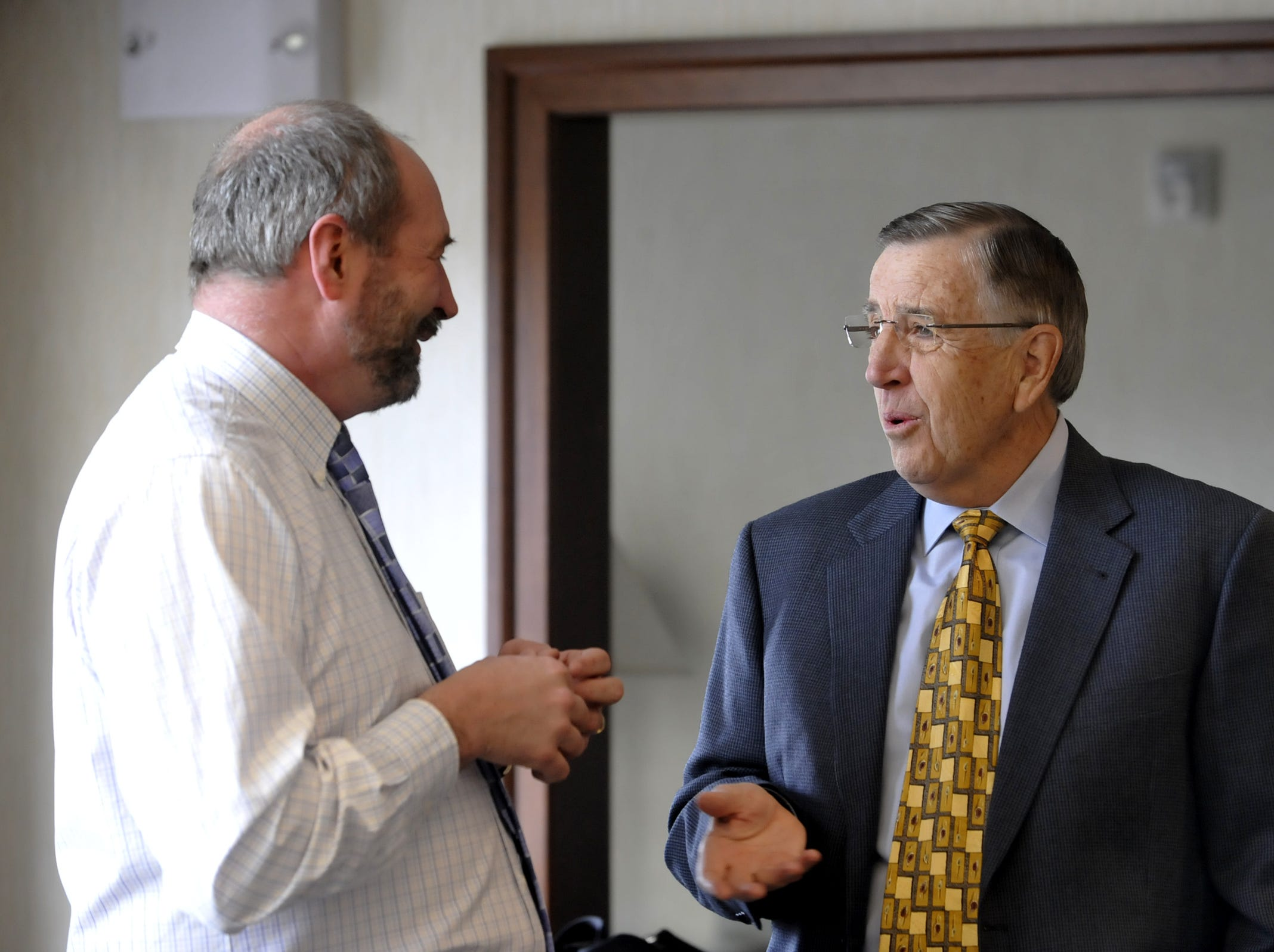 Longtime sports announcer and Montana  Brent Musburger, right, talks with MSU's Bill Lamberty, Friday at the Staybridge Suites in Great Falls, Mont.  Musburger was the guest speaker at Friday evening's Triangle Classic banquet.