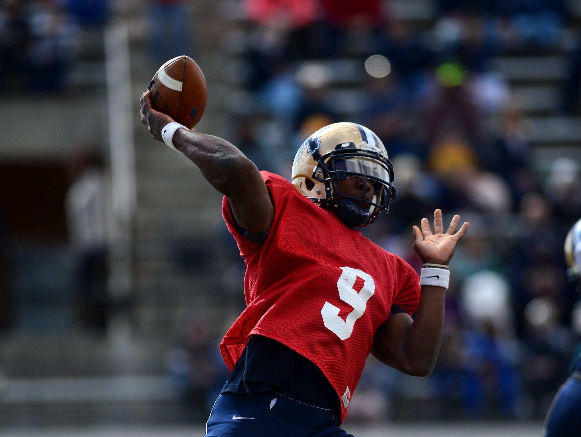 MSU quarterback DeNarius McGhee throws downfield on Saturday during the Triangle Classic.TRIBUNE PHOTO/RION SANDERS