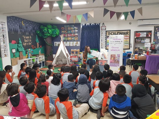 Local author, Jennifer Senne, reads her book Good Morning, Mirror to the first-grade class at iLearn Academy Charter School. Senne was part of a select group of readers that were invited to read to students during the schools' Read-a-Thon spirit week celebration.