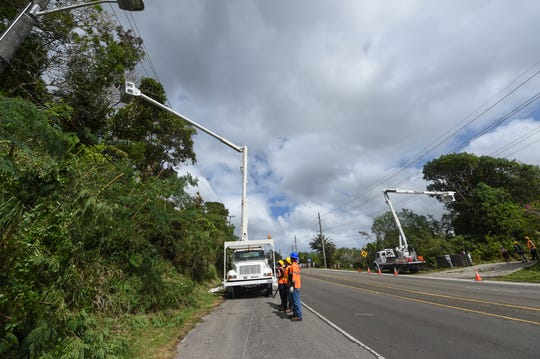 In this Feb. 22 file photo, Guam Power Authority crews trim trees by Route 4 in Chalan Pago.
