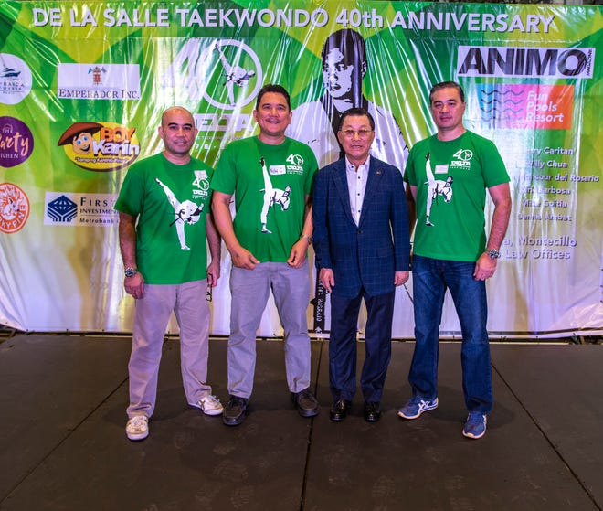 Noly Caluag, chief instructor of Guam Taekwondo Center recently attended the 40th anniversary reunion of the De La Salle Taekwondo Association, also known as DELTA in the Philippines. An alumnus of De La Salle University, Caluag was a founding member, president and team captain of DELTA.  During his presidency, Caluag went on to win a gold medal in the first Philippine National Taekwondo Championships in 1979, and eventually represented the Philippines in the World and Asian Taekwondo Championships. In 2000, Caluag got the gold medal in the California Taekwondo Open Championships held in Los Angeles. For his achievements in Taekwondo, his alma mater awarded Caluag the 1st Taekwondo Sports Hall of Famer in 2003.  Caluag, 2nd from left, was honored together with other Sports Hall of Famers Stephen Fernandez, to his right, and Congressman Monsour Del Rosario to his far left. All three were coached by Grandmaster Hong Sung Chon, current chairman of the Kukkiwon World Taekwondo.