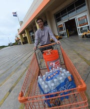 Zachary Martir with some typhoon preparation supplies at Home Depot in Tamuning on Feb. 22, 2019.