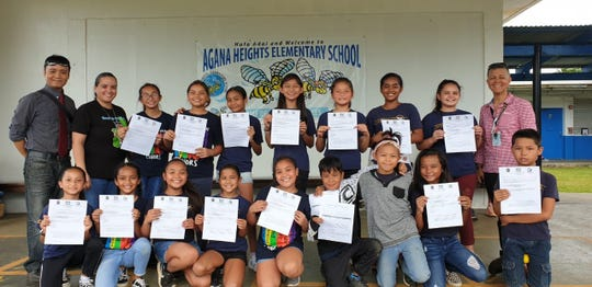 The Agana Heights Elementary School GATE Dance Program, under the direction of C'zer Medina, awarded the Top 10 dancers with their 6 understudy dancers. Kneeling from left: Kelly-Haze Duenas, Aeriana Untalan, Marii Manipol, Bailee Santiago, Mea Manipol, Kaleb Duenas, Ethan Blas, Ava-Rae Lujan (understudy), and Gregorio Certeza (understudy). Standing from left: Medina (GATE Dance Teacher), Stepanie Taitano (AHES GATE teacher), Camille Leon Guerrero (understudy), Delanie Salas, Vera Laserna, Sophia Taitano, Abigail Burch (understudy), Aisek Rinta (understudy), Aubrey Flores (understudy), and Hannah Gutierrez (AHES principal).