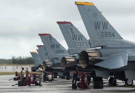 U.S. Air Force Airmen from the 13th Fighter Squadron from Misawa Air Base, Japan, stands by for F-16 Fighting Falcon's to taxi onto a runway on Andersen Air Force Base, Guam, during COPE North 19 on Feb 19, 2019. COPE North is an annual multilateral U.S. Pacific Air Forces-sponsored field training exercise focused on combat air forces large-force employment and mobility air forces humanitarian assistance and disaster relief training to enhance interoperability among U.S., Australian and Japanese forces. (U.S. Air Force Photo by Senior Airman Xavier Navarro)