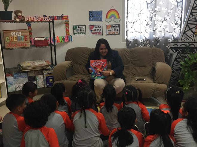 Honorable Speaker Tina Muña-Barnes reads to a kindergarten class at iLearn Academy Charter School. Muña-Barnes was part of a select group of readers that were invited to read to students during the schools' Read-a-Thon spirit week celebration.