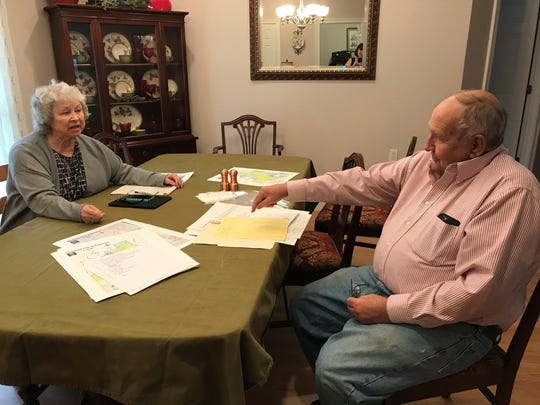 James and Dianne Williams look over their plans to oppose a new quest to incorporate the Bellevue community.