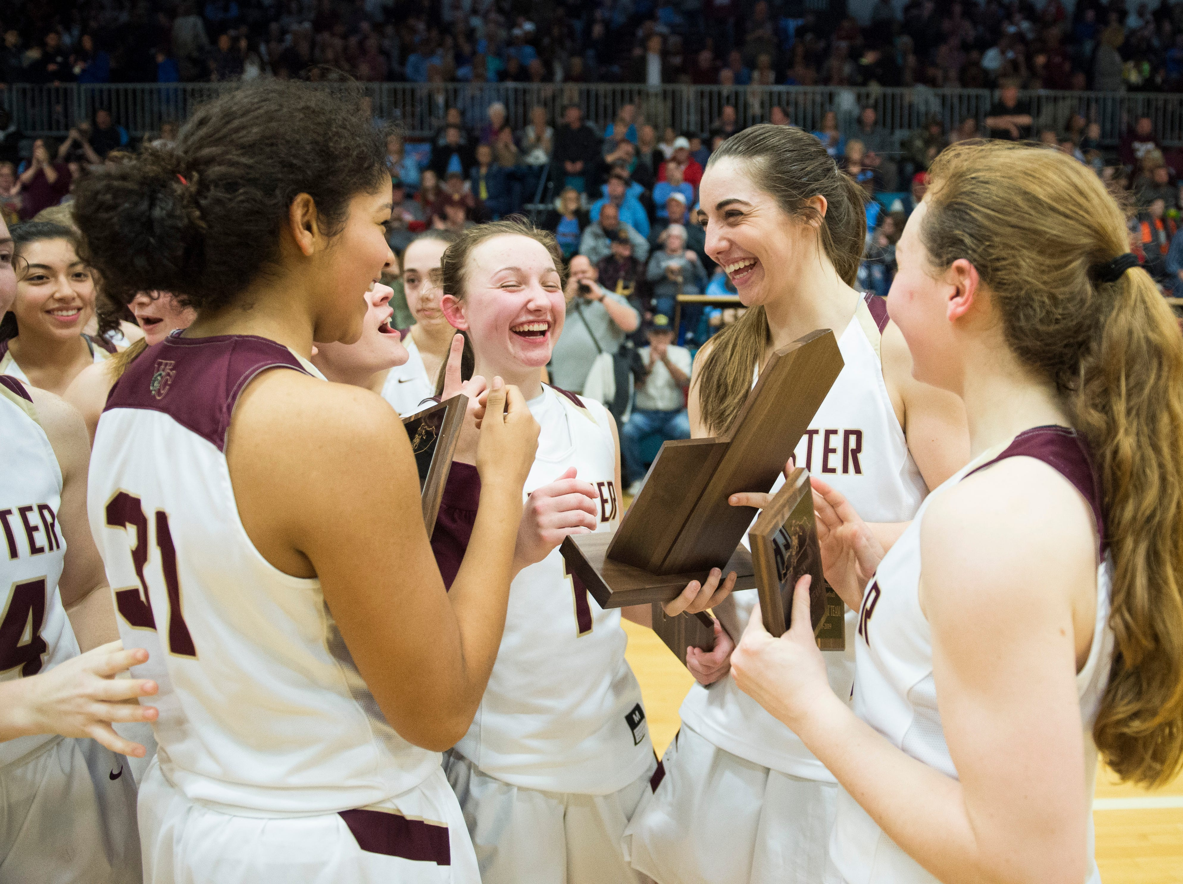 Webster County Lady Trojans celebrate after beating the Henderson County Lady Colonels in the 2019 Sixth District championship game at Union County High School Thursday, Feb. 21, 2019.