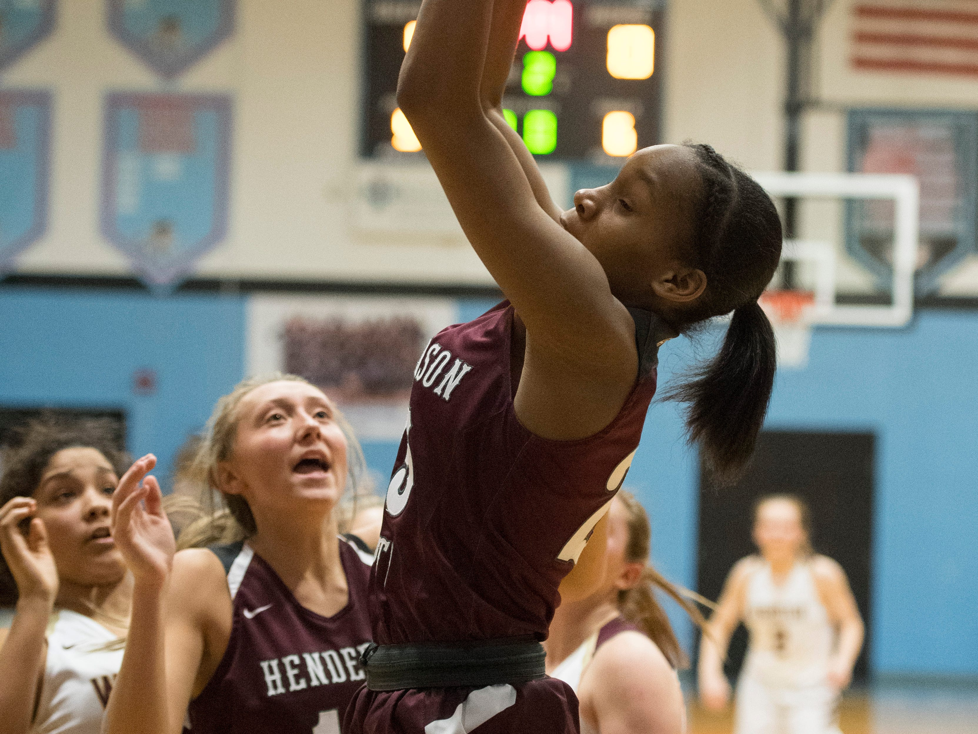 Henderson County's Jarie Thomas (3) pulls down a rebound during the 2019 Sixth District championship game against the Webster County Lady Trojans at Union County High School Thursday, Feb. 21, 2019.