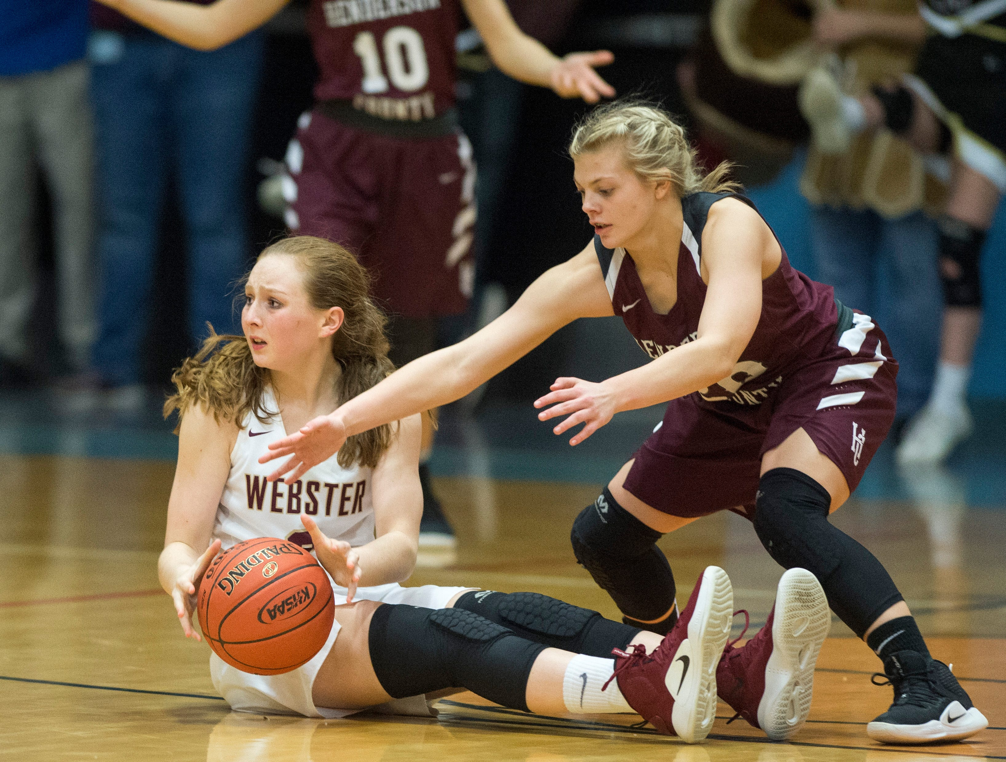 Webster County's Marissa Austin (2)  struggles to find an open teammate after falling to the floor during the 2019 Sixth District championship game against the Henderson County Lady Colonels at Union County High School Thursday, Feb. 21, 2019.