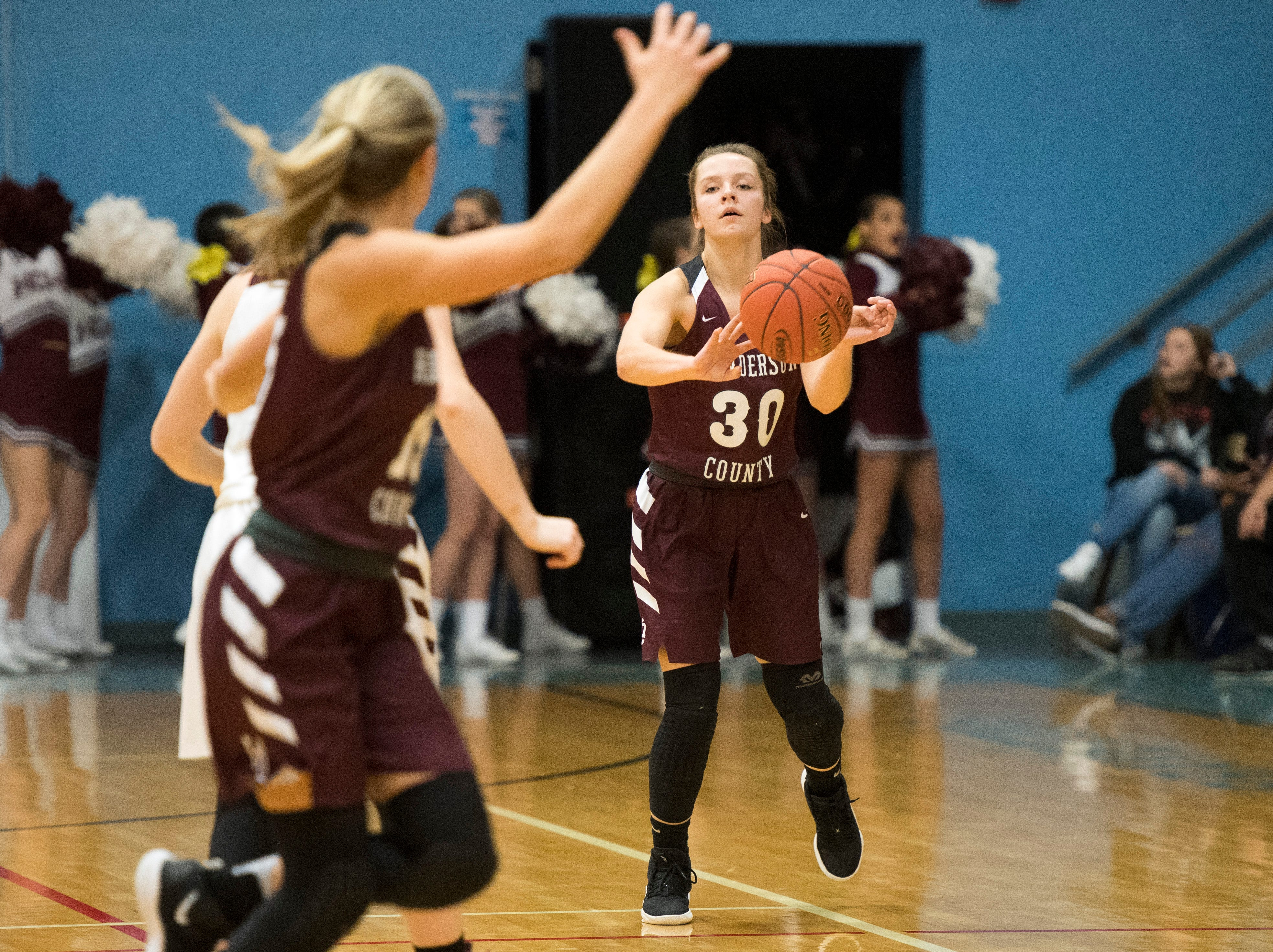 Henderson County's Emilee Hope (30) passes the ball to Henderson County's Alyssa Dickson (15) during the 2019 Sixth District championship game against the Webster County Lady Trojans at Union County High School Thursday, Feb. 21, 2019.