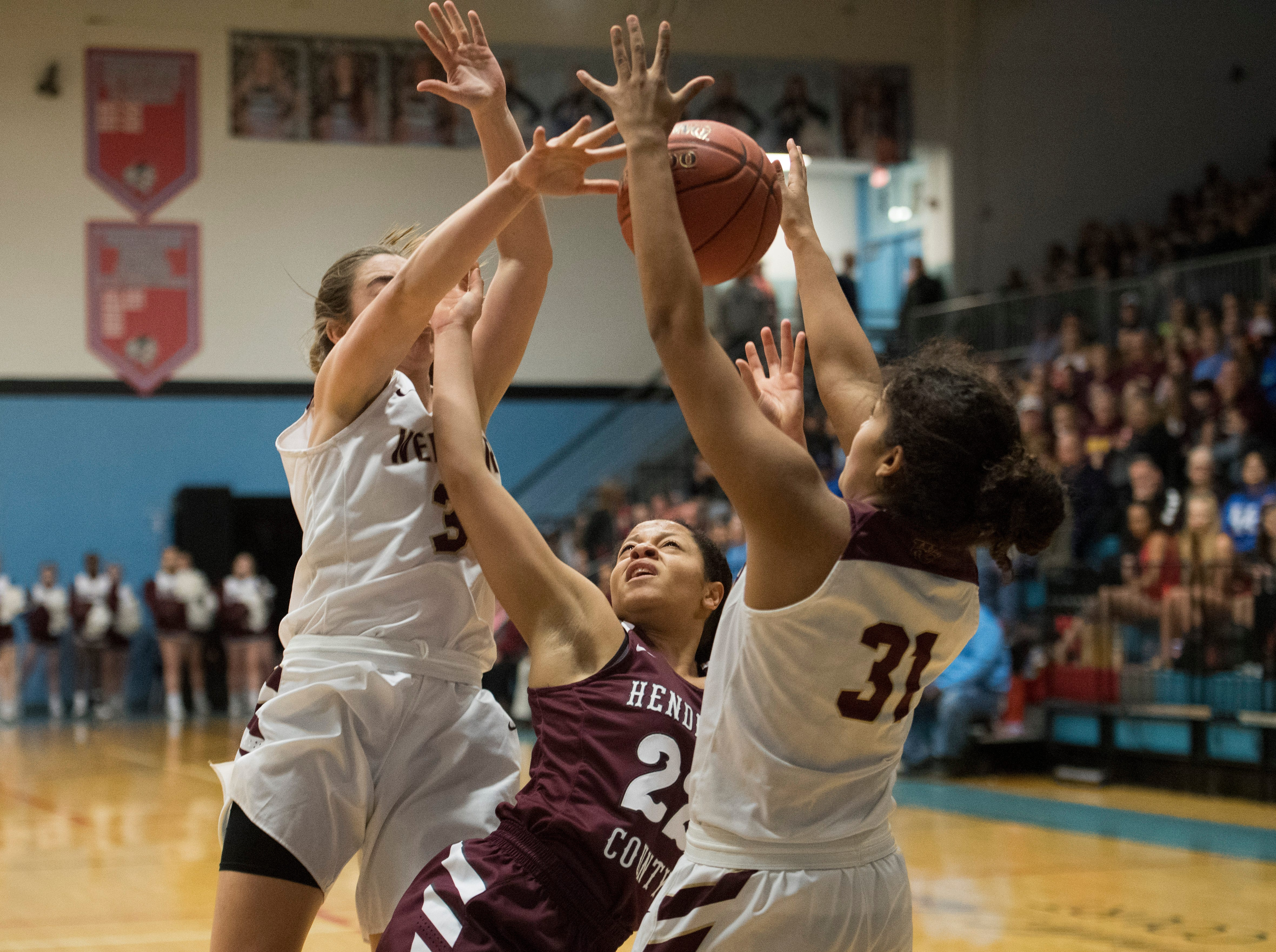 Henderson County's Lauren Hubbard (22) is blocked by Trojan defense during the 2019 Sixth District championship game against the Webster County Lady Trojans at Union County High School Thursday, Feb. 21, 2019.