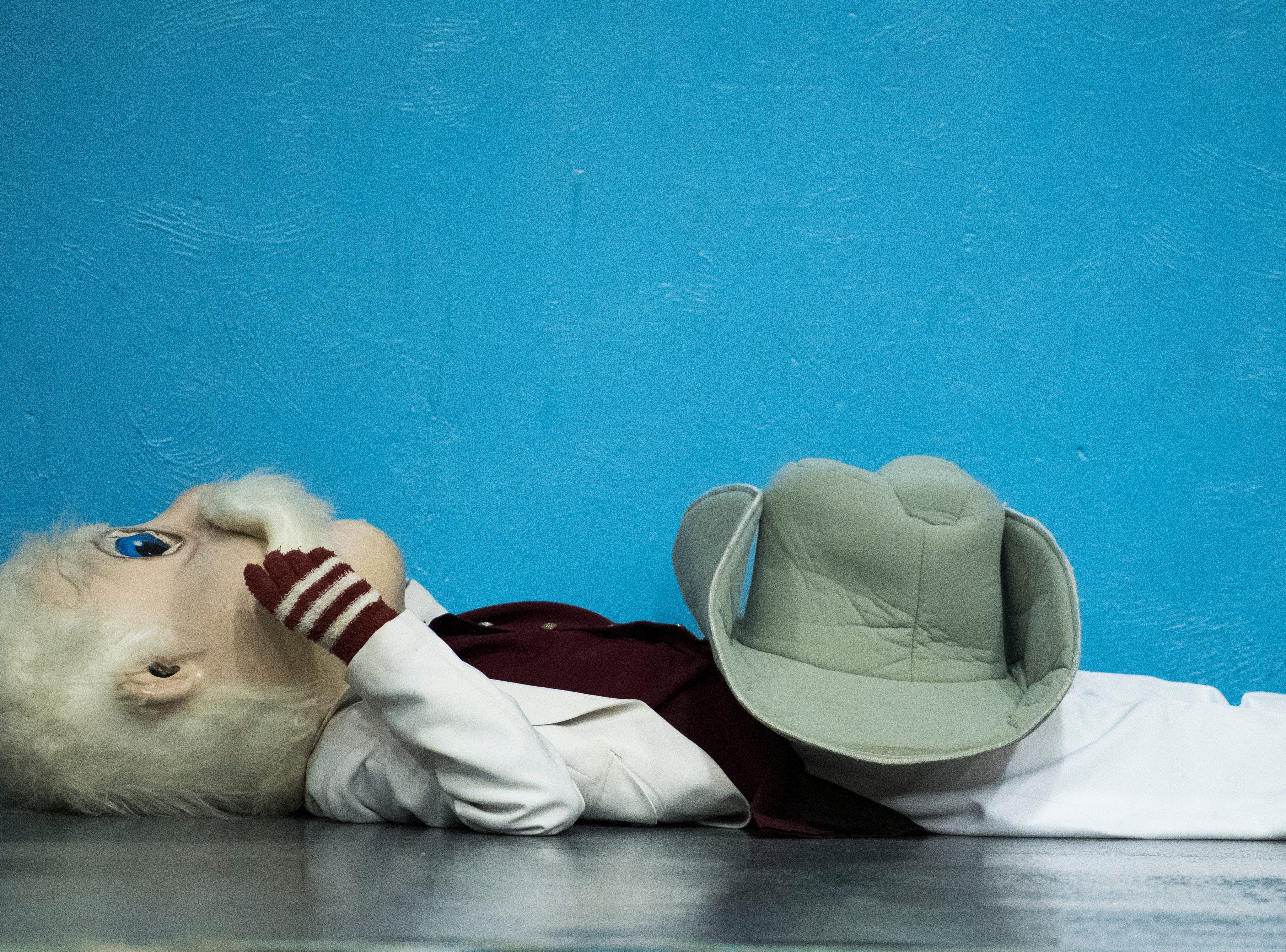 The Henderson Colonels mascots rest on the ground twirling its mustache after loosing to the Union County Braves in the  2019 Sixth District championship game at Union County High School Thursday, Feb. 21, 2019.