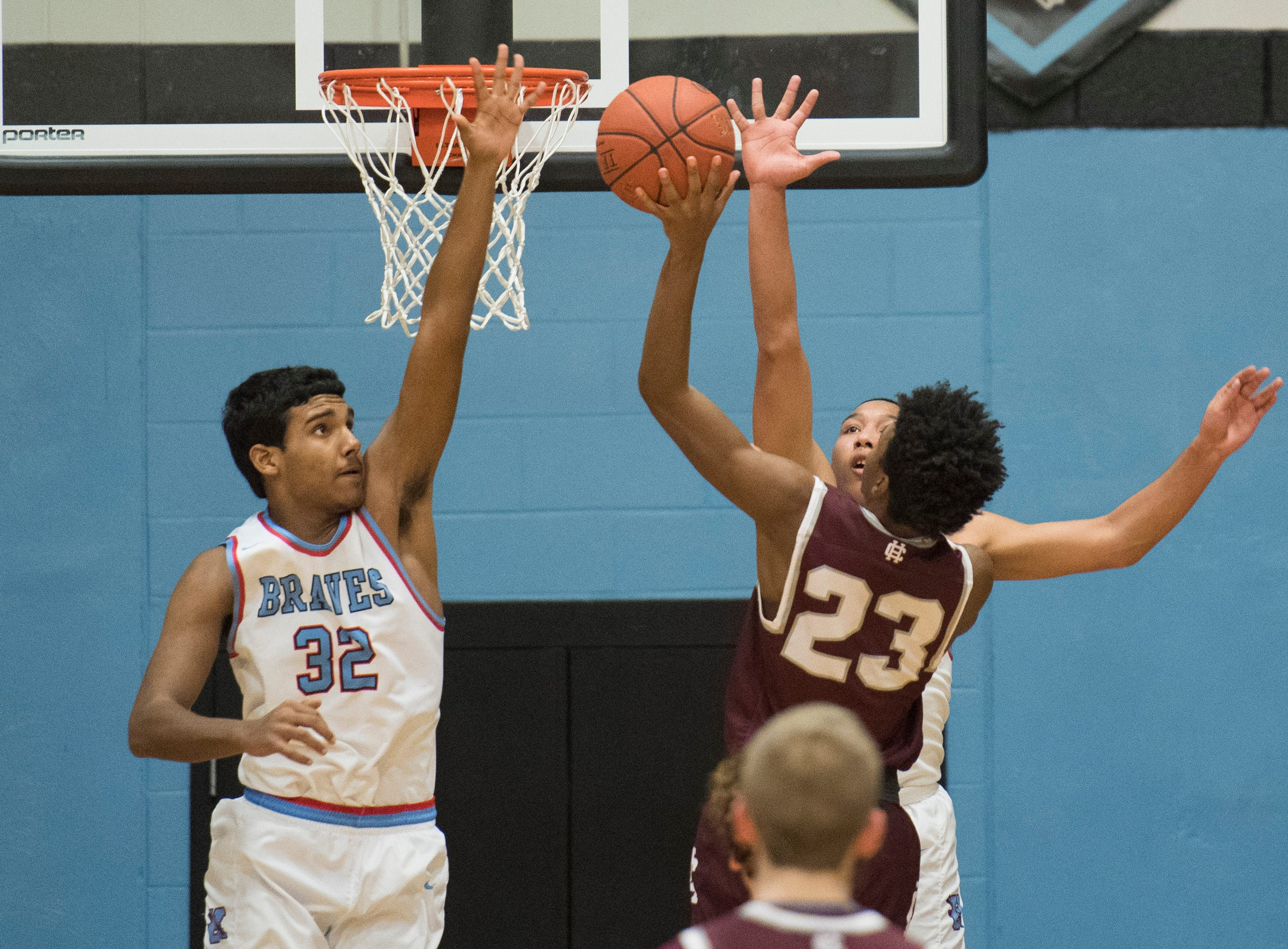 Union County's Clem Johnson (32) and Union County's Kaleb Kanipe (2) attempts to block Henderson's Myekel Sanners (23) shot during the 2019 Sixth District championship game against the Henderson County Colonels at Union County High School Thursday, Feb. 21, 2019.
